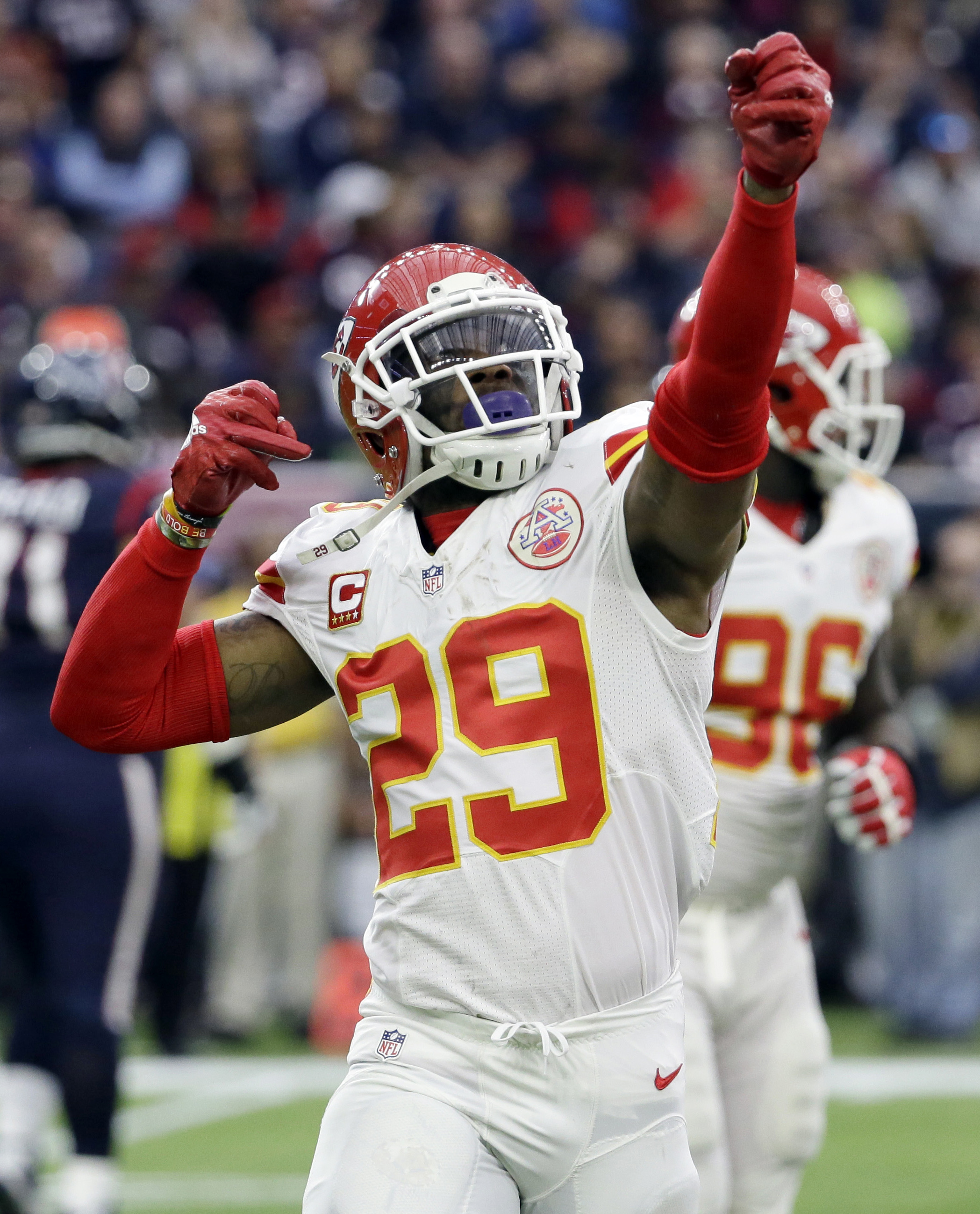 FILE - In this Jan. 9, 2016, file photo, Kansas City Chiefs free safety Eric Berry celebrates after an interception against the Houston Texans during an NFL wild-card football game in Houston.  The Chiefs placed the franchise tag on Berry on Tuesday, Marc