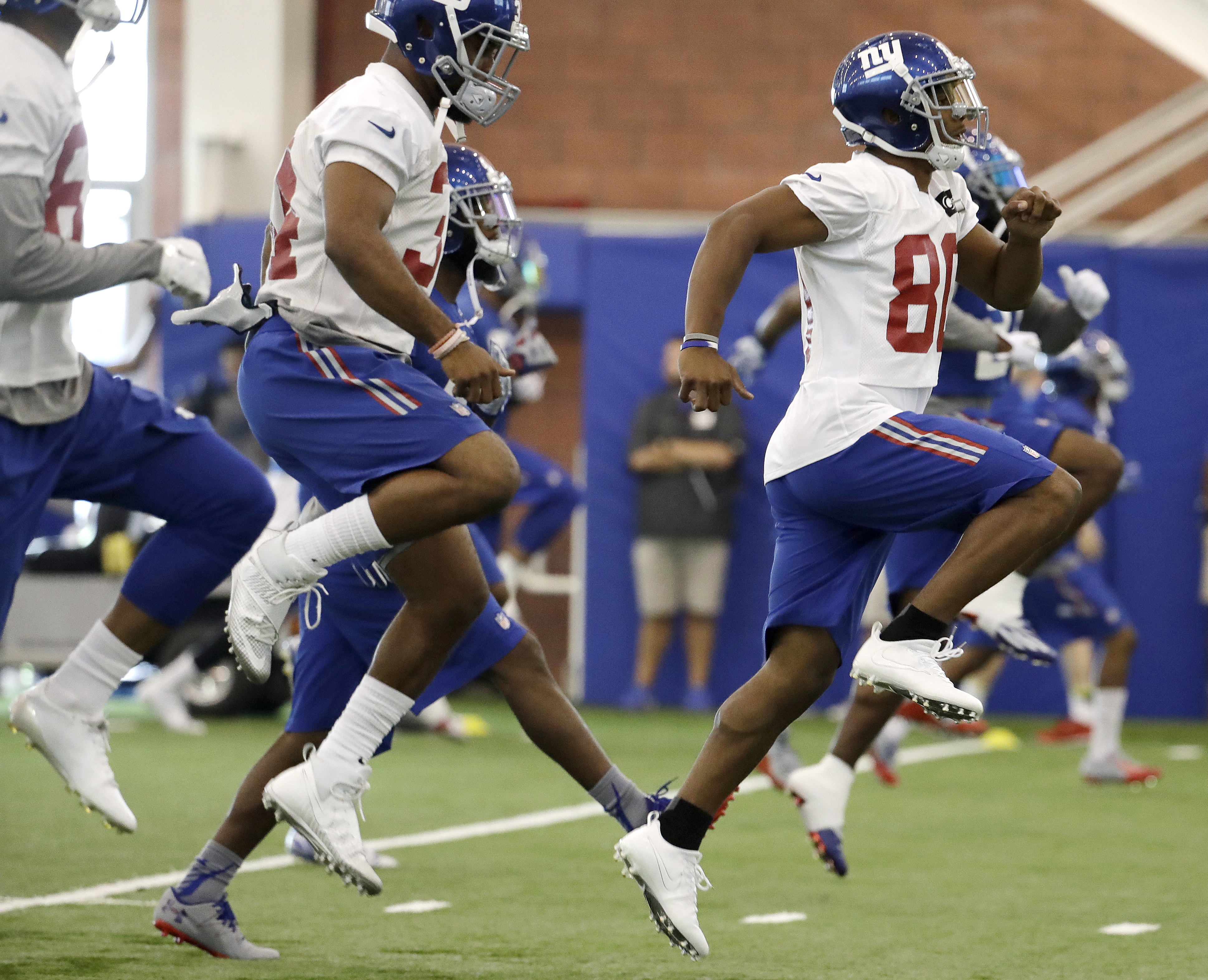 FILE - In this July 29, 2016, file photo, New York Giants wide receiver Victor Cruz, right, runs a drill during NFL football training camp in East Rutherford, N.J. An NFL game Saturday, Aug. 27, 2016, includes Cruz playing for the first time since tearing
