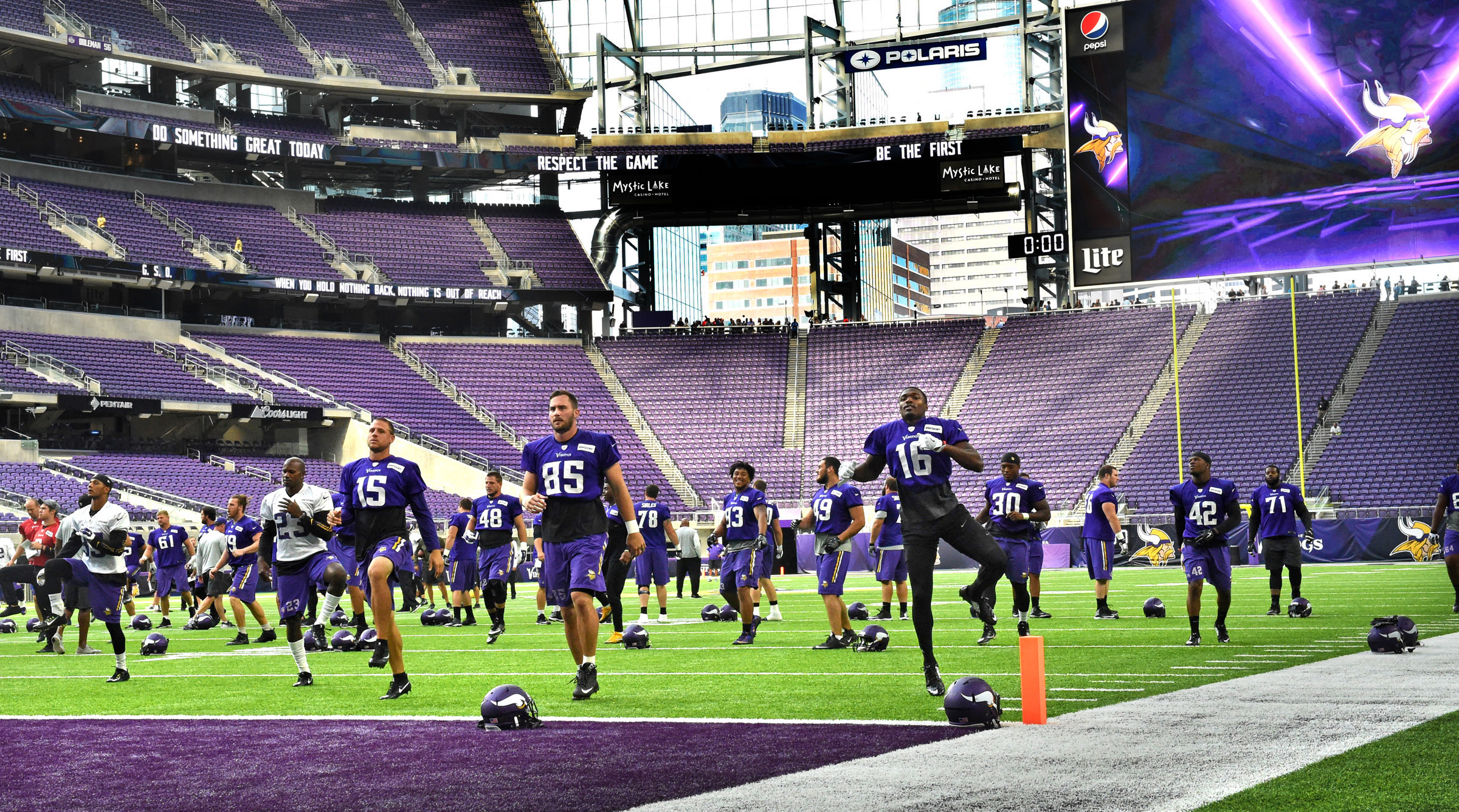 Minnesota Vikings players stretch before their first NFL football practice at U.S. Bank Stadium in Minneapolis, Friday, Aug. 26, 2016. The Vikings will face the San Diego Chargers in a preseason game Sunday, the first for the team at their new stadium. (P