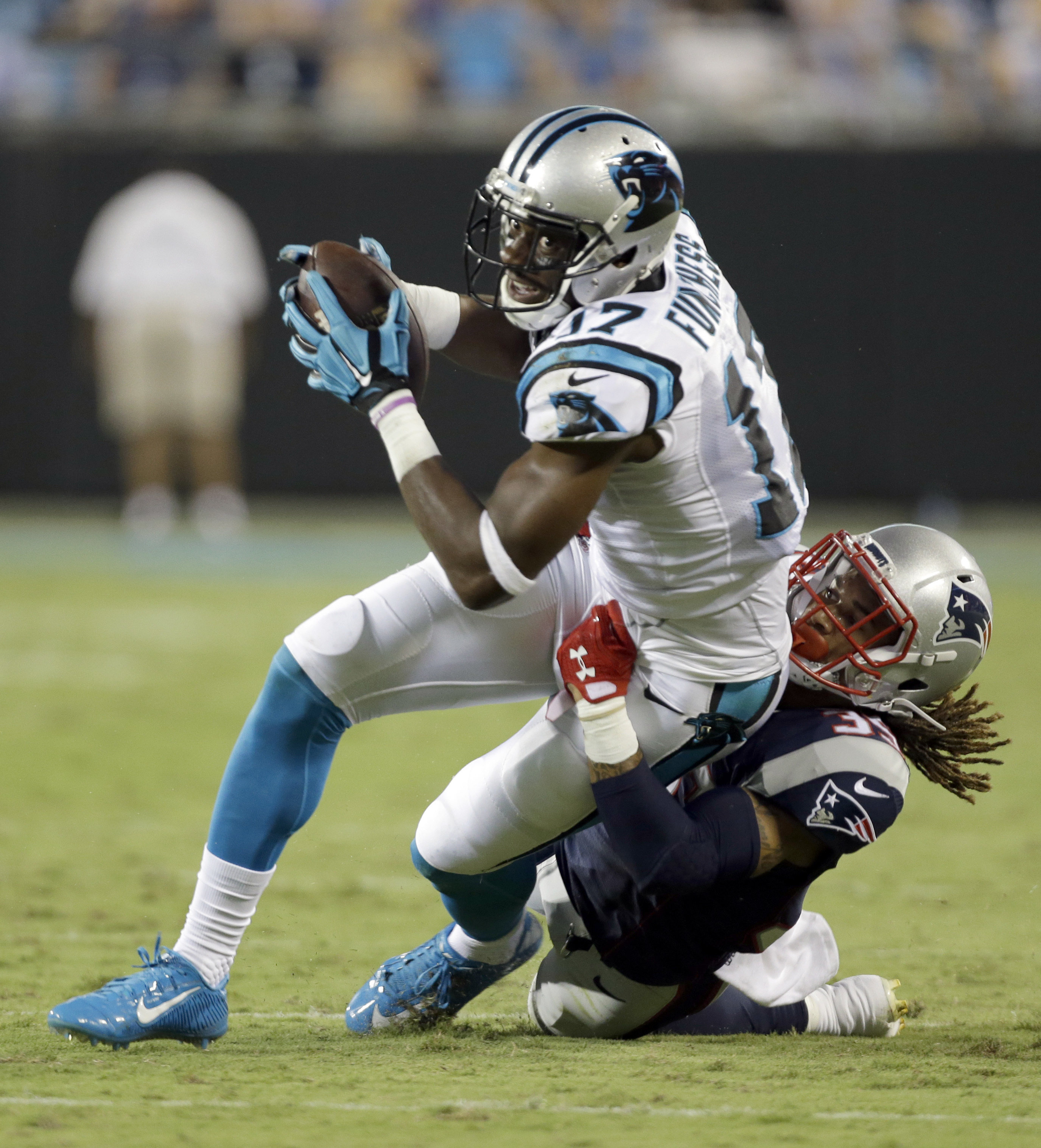 Carolina Panthers' Devin Funchess (17) is tackled by New England Patriots' Cre'von LeBlanc (35) during the first half of a preseason NFL football game in Charlotte, N.C., Friday, Aug. 26, 2016. (AP Photo/Bob Leverone)