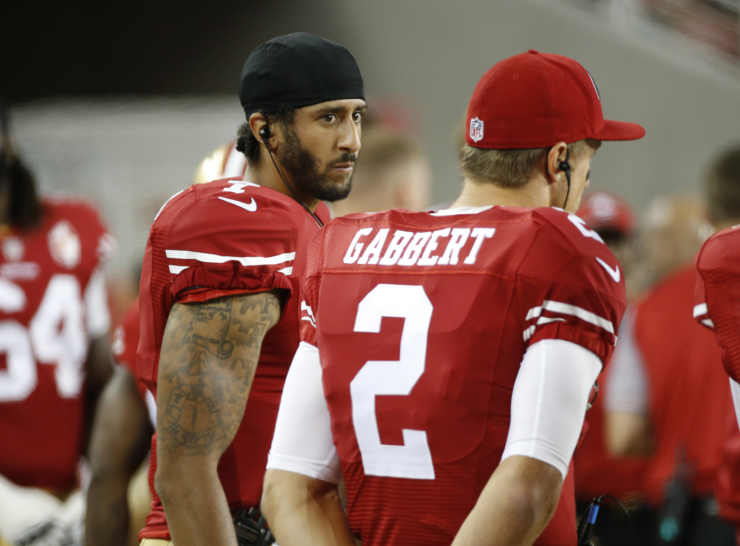 San Francisco 49ers quarterbacks Colin Kaepernick, left, and Blaine Gabbert stand on the sideline during the second half of an NFL preseason football game against the Green Bay Packers on Friday, Aug. 26, 2016, in Santa Clara, Calif. Green Bay won 21-10.