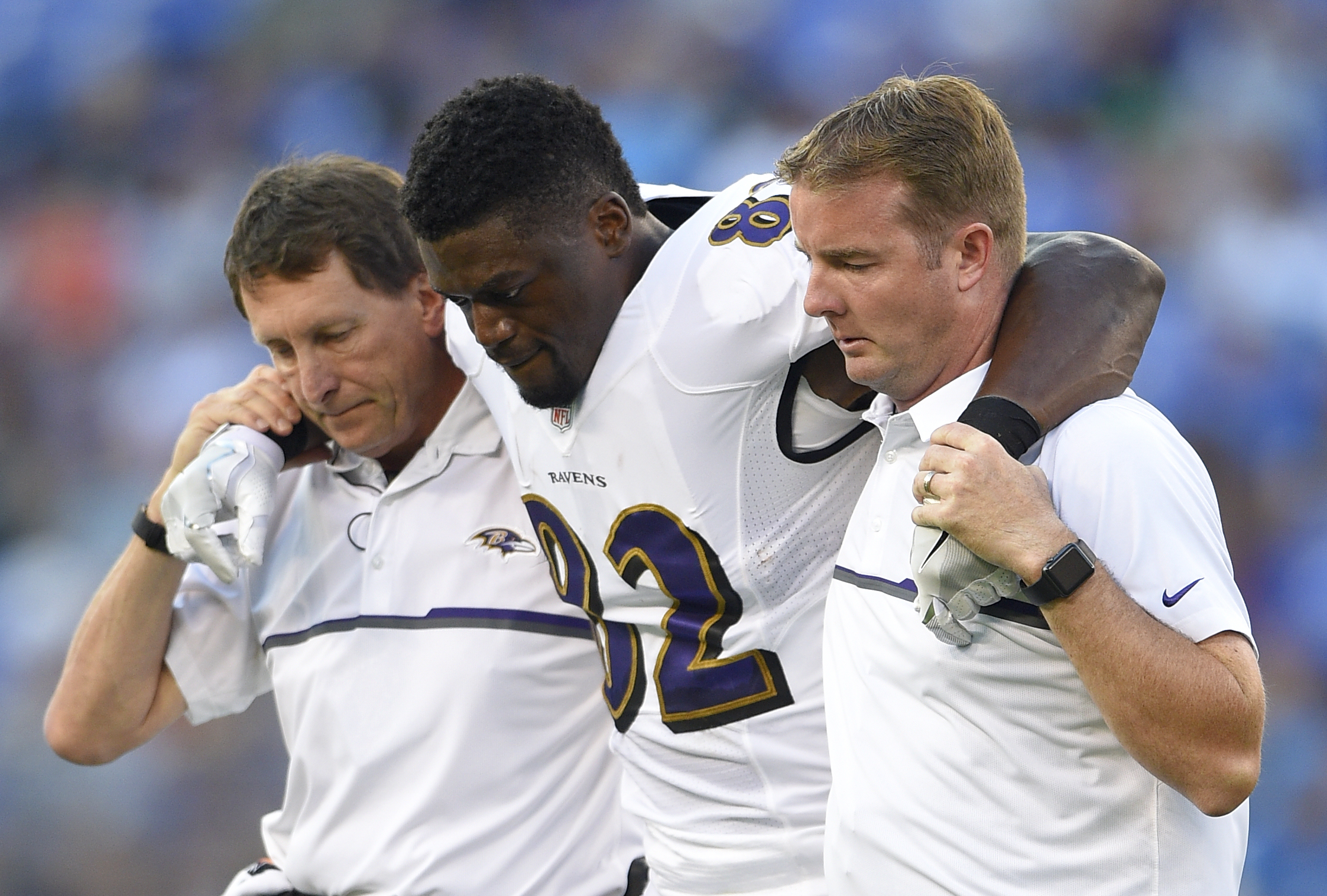 Baltimore Ravens tight end Benjamin Watson is assisted off the field after injuring himself in the first half of a preseason NFL football game against the Detroit Lions, Saturday, Aug. 27, 2016, in Baltimore. (AP Photo/Nick Wass)