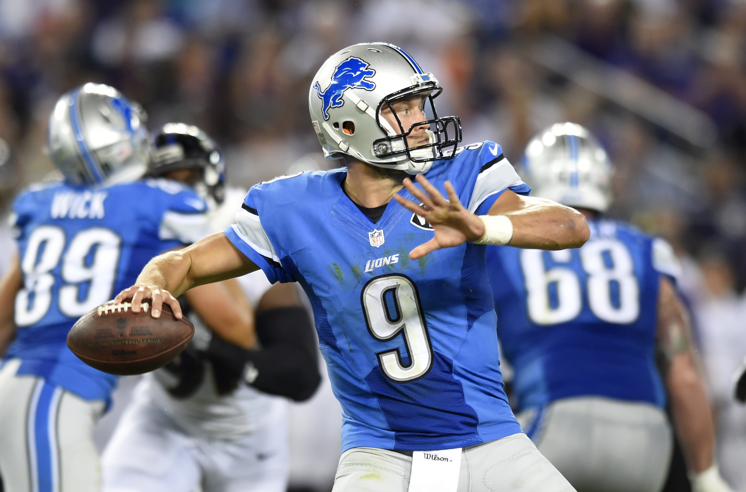 Detroit Lions quarterback Matthew Stafford (9) throws to a receiver in the first half of a preseason NFL football game against the Baltimore Ravens, Saturday, Aug. 27, 2016, in Baltimore. (AP Photo/Gail Burton)