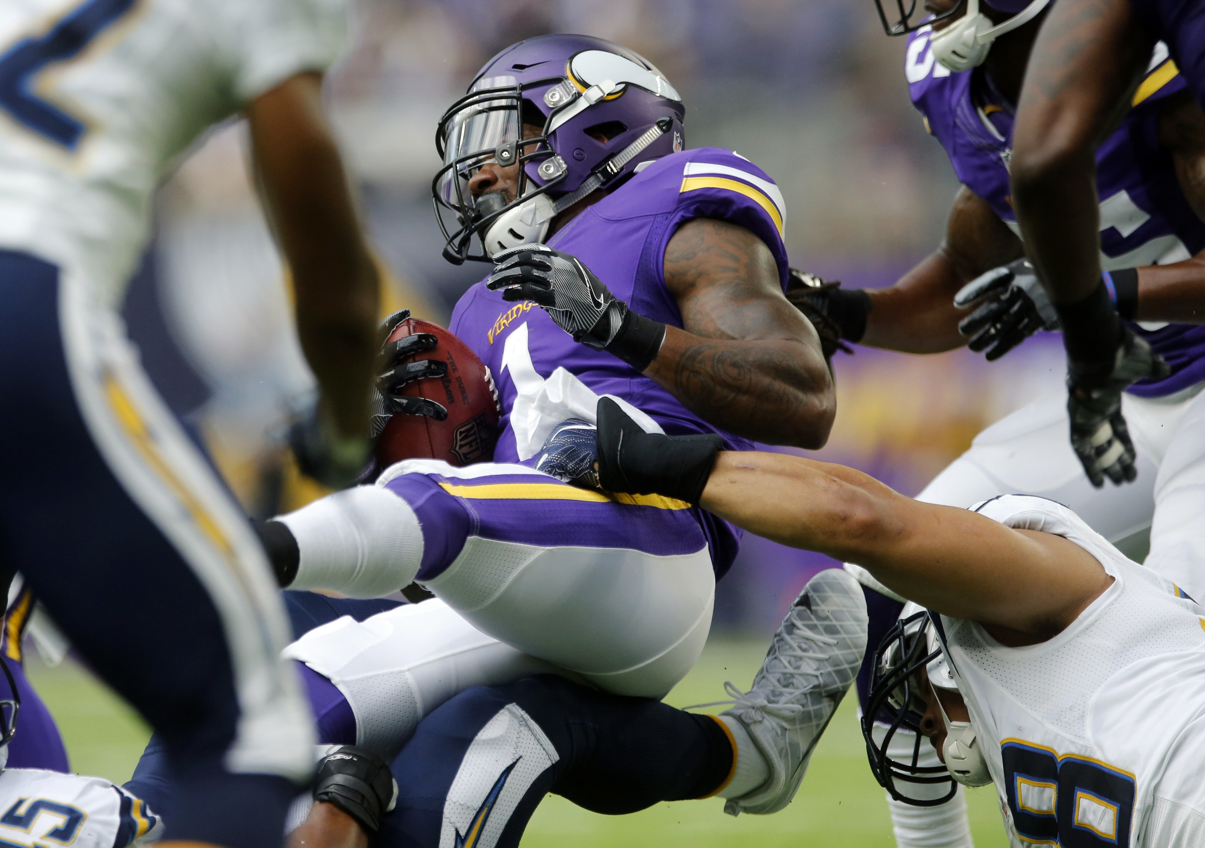 Minnesota Vikings wide receiver Troy Stoudermire (1) is tackled by San Diego Chargers outside linebacker Tourek Williams, lower right, during the second half of an NFL preseason football game Sunday, Aug. 28, 2016, in Minneapolis. (AP Photo/Jim Mone)