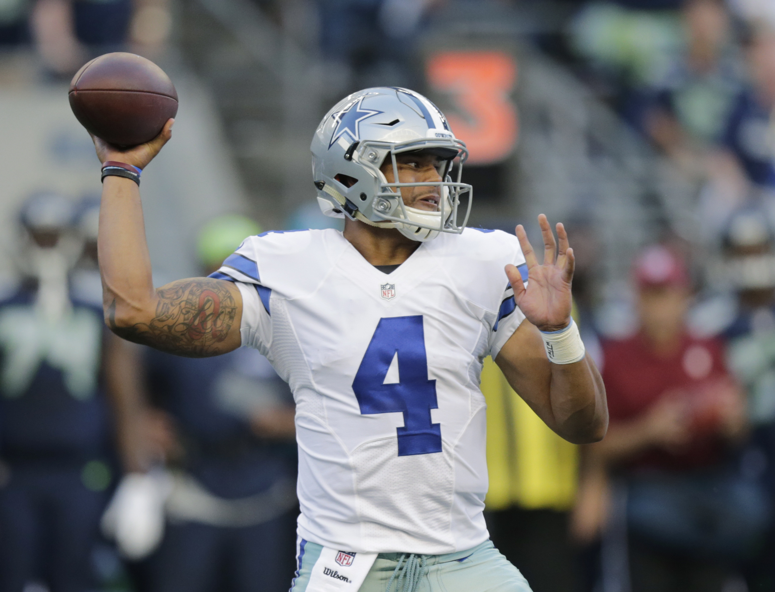 FILE - This Aug. 25, 2016 file photo shows Dallas Cowboys quarterback Dak Prescott passing against the Seattle Seahawks during the first half of a preseason NFL football game in Seattle. Prescott grew up rooting for the Dallas Cowboys in Louisiana and sud