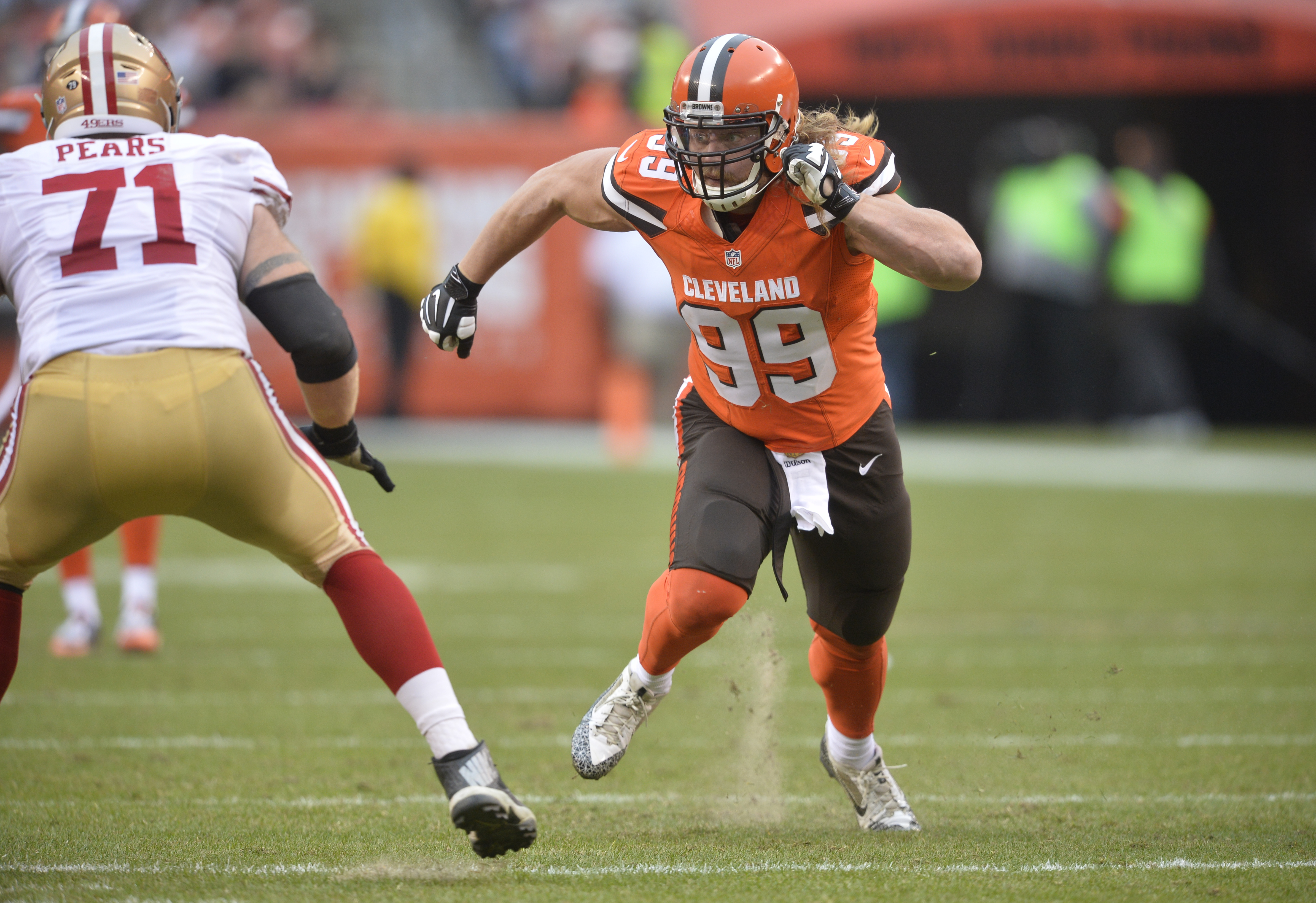 FILE - In this Dec. 13, 2015, file photo, Cleveland Browns outside linebacker Paul Kruger (99) rushes the passer against the San Francisco 49ers during an NFL football game, in Cleveland. The Browns have released linebacker Paul Kruger, a startling move i