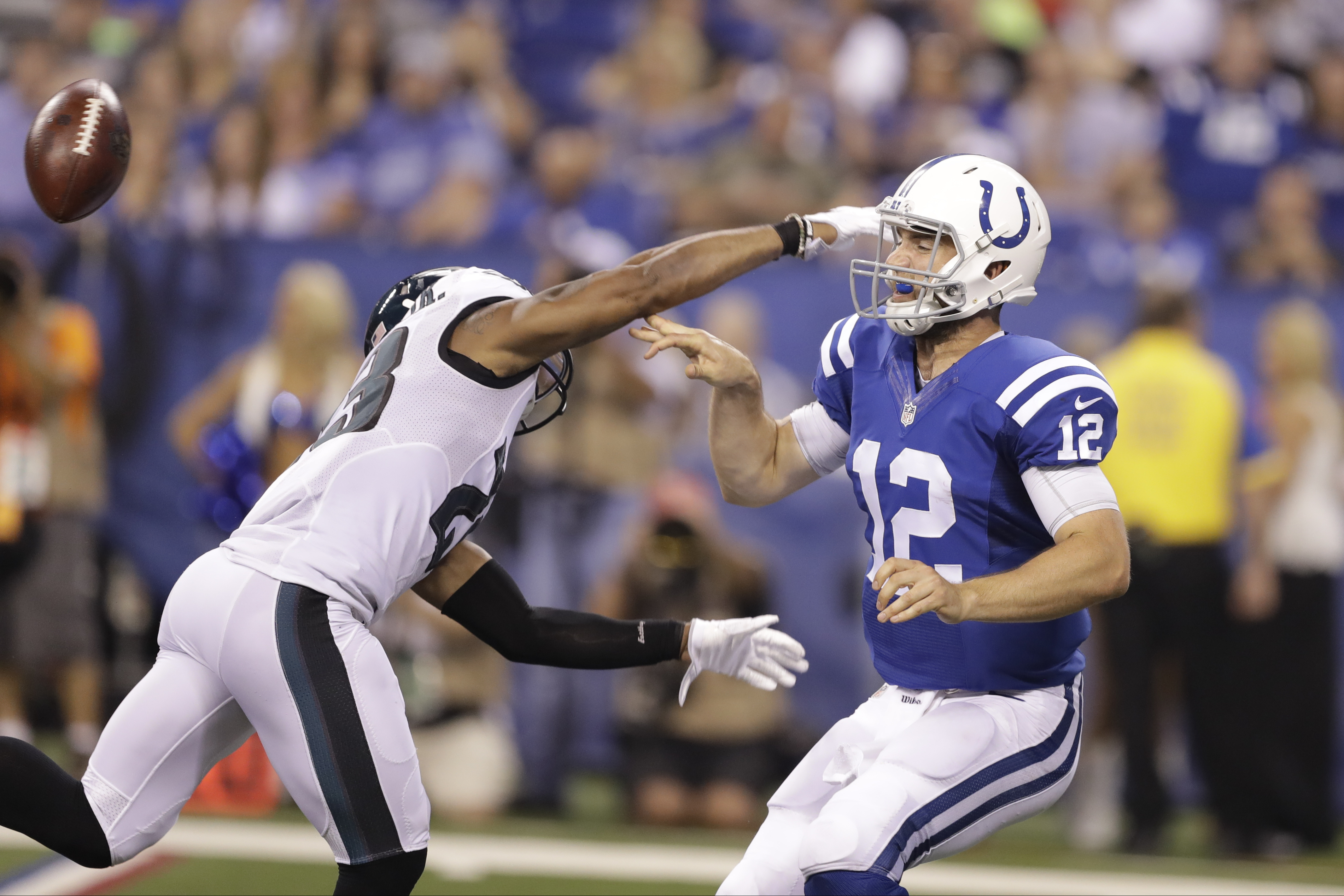 FILE - In this Aug. 27, 2016, file photo, Philadelphia Eagles defensive back Rodney McLeod (23) chases Indianapolis Colts quarterback Andrew Luck (12) during the first half of an NFL preseason football game in Indianapolis. Luck is healthy, and the Colts