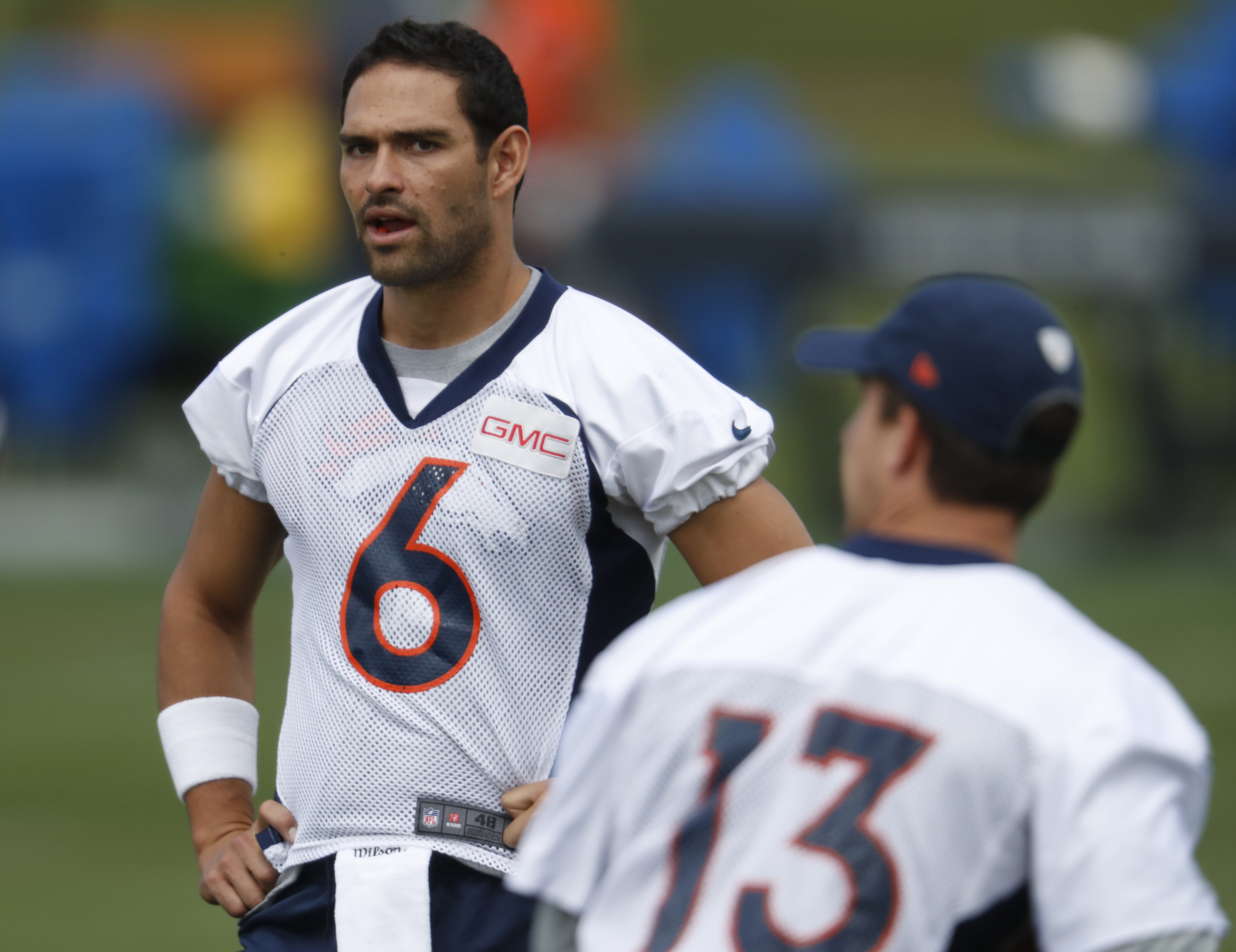 Denver Broncos quarterback Mark Sanchez, back, looks as as quarterback Trevor Siemian takes part in a drill during the team's NFL football practice at the Broncos' headquarters on Monday, Aug. 29, 2016, in Englewood, Colo. (AP Photo/David Zalubowski)
