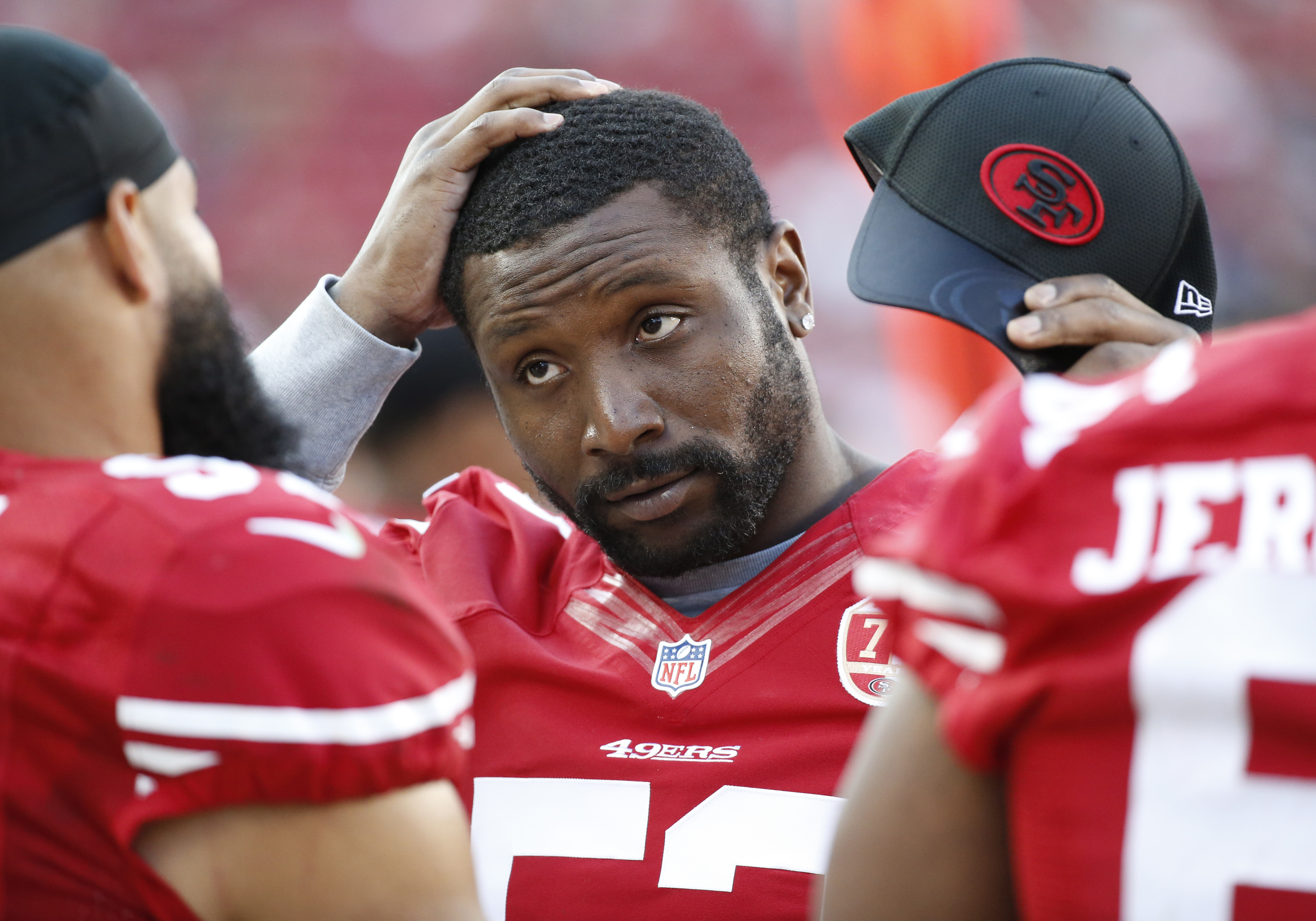 This Aug. 14, 2016 photo shows San Francisco 49ers inside linebacker NaVorro Bowman standing on the sidelines during the second half of an NFL preseason football game in Santa Clara, Calif. The 49ers have taken a rapid fall from perennial NFC contender to
