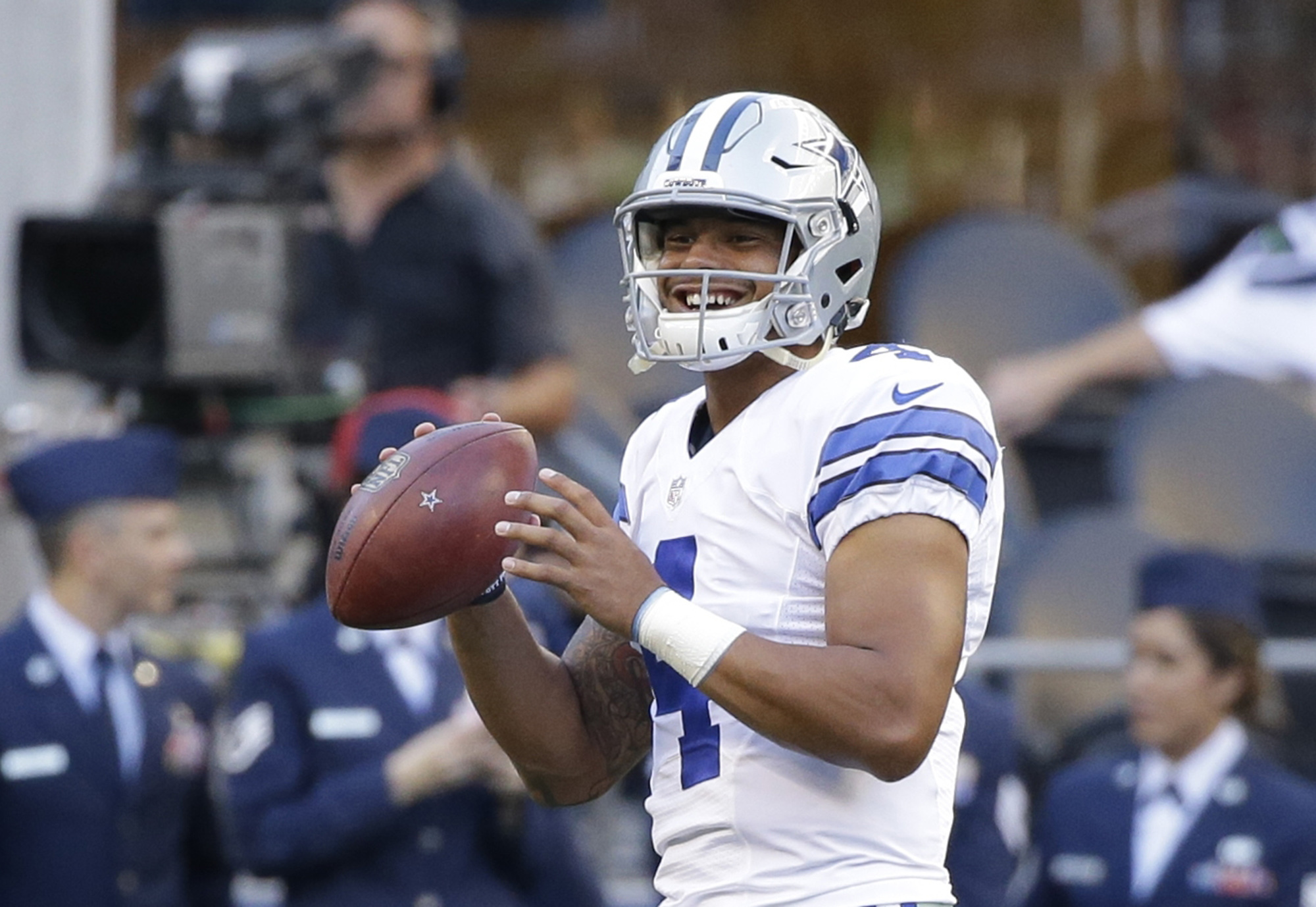 FILE - In this Aug. 25, 2016, file photo, Dallas Cowboys quarterback Dak Prescott passes during warmups before a preseason NFL football game against the Seattle Seahawks, in Seattle. The Cowboys are Prescott's team while Romo is out with a back injury.(AP