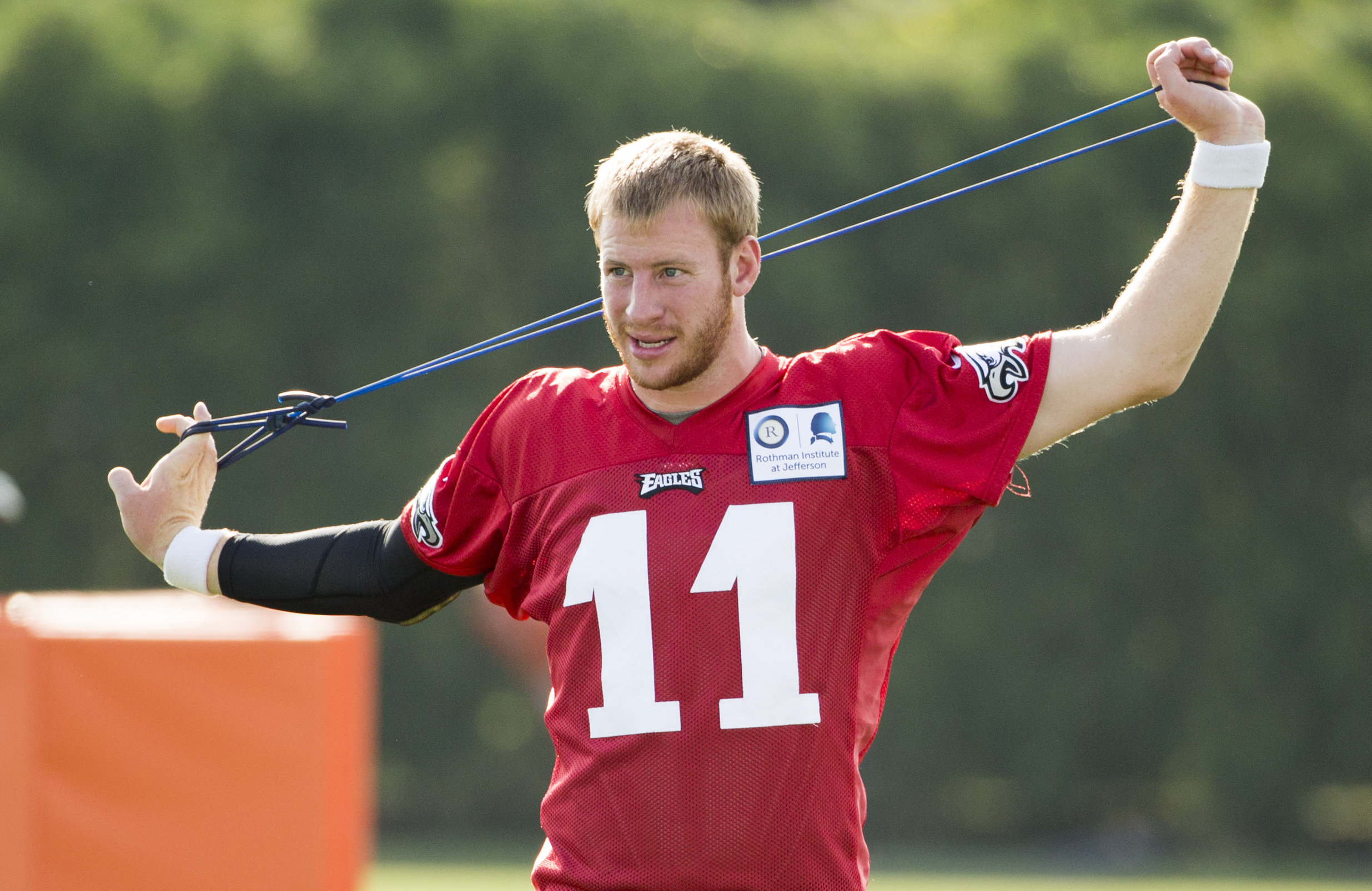 FILE - In this July 26, 2016, file photo, Philadelphia Eagles quarterback Carson Wentz stretches during practice at NFL football training camp, in Philadelphia. The Eagles traded a slew of picks to select Wentz at No. 2 in the draft, but he was slated to