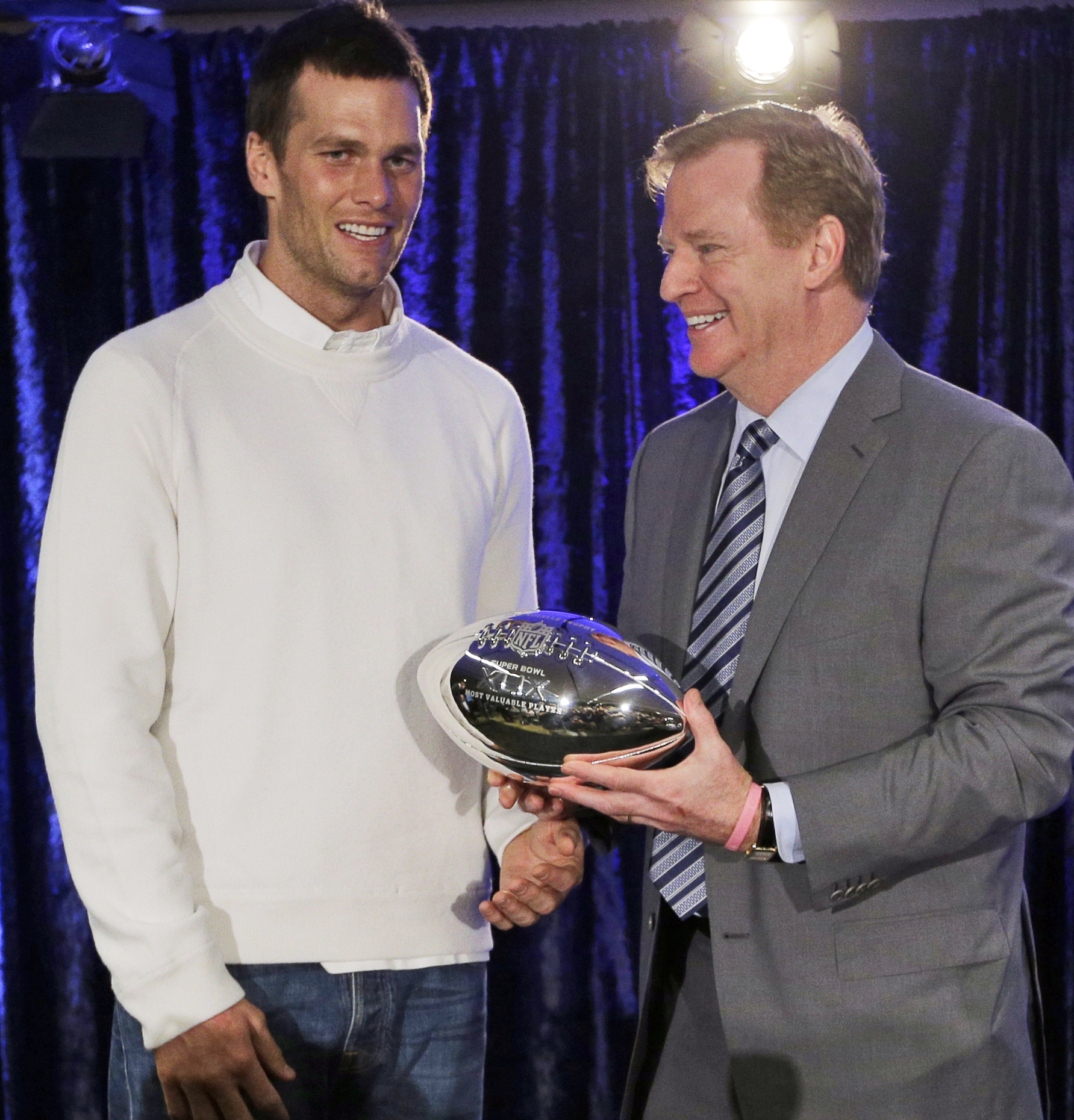 FILE - In this Feb. 2, 2015, file photo, New England Patriots quarterback Tom Brady poses with NFL Commissioner Rodger Goodell during a news conference after NFL football's Super Bowl XLIX in Phoenix, Ariz. Sept. 1 marks 10 years that  Goodell has served