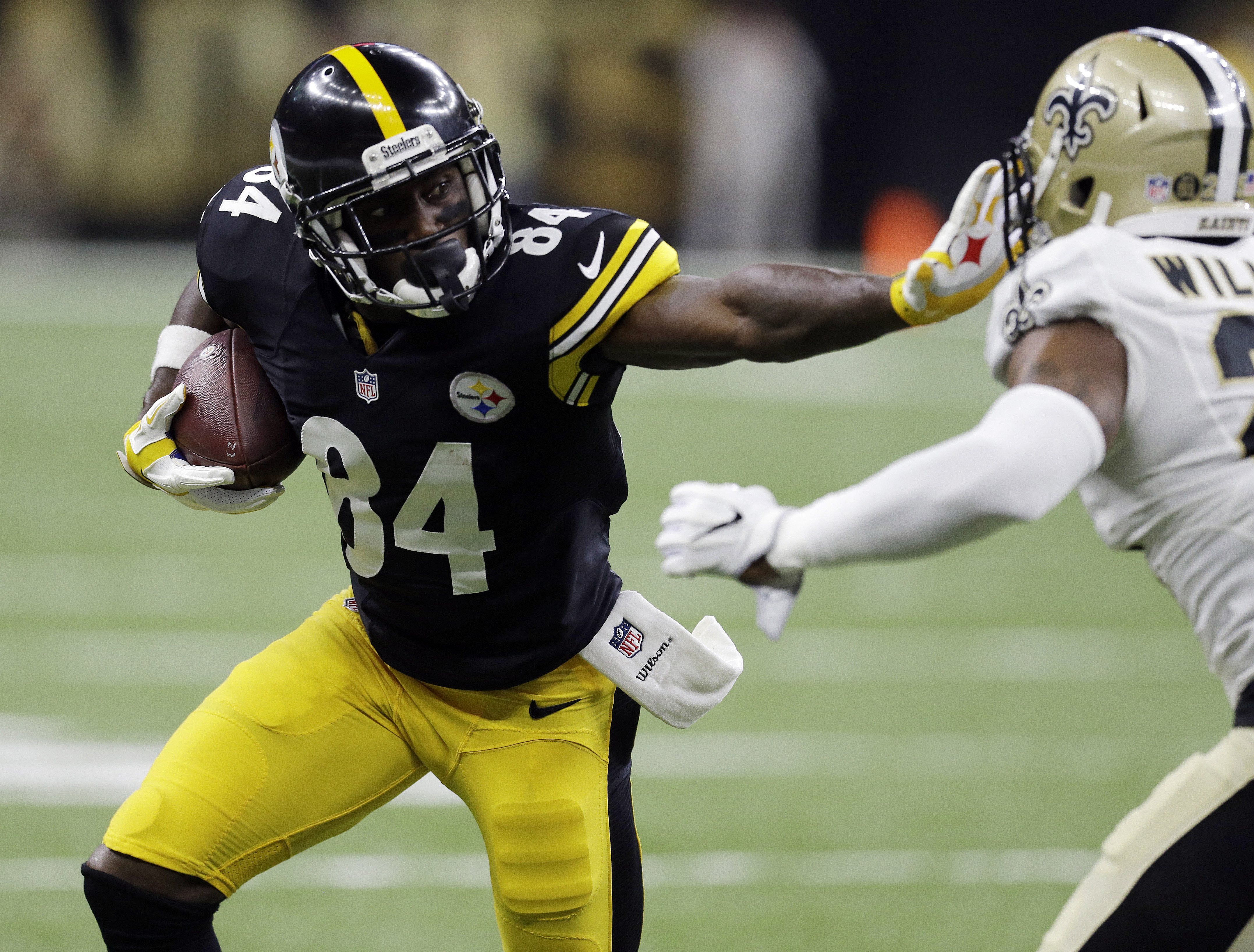 FILE - In this Aug. 26, 2016, file photo, Pittsburgh Steelers wide receiver Antonio Brown (84) runs against New Orleans Saints cornerback P.J. Williams (25) in the first half of an NFL preseason football game in New Orleans.  A person familiar with the de