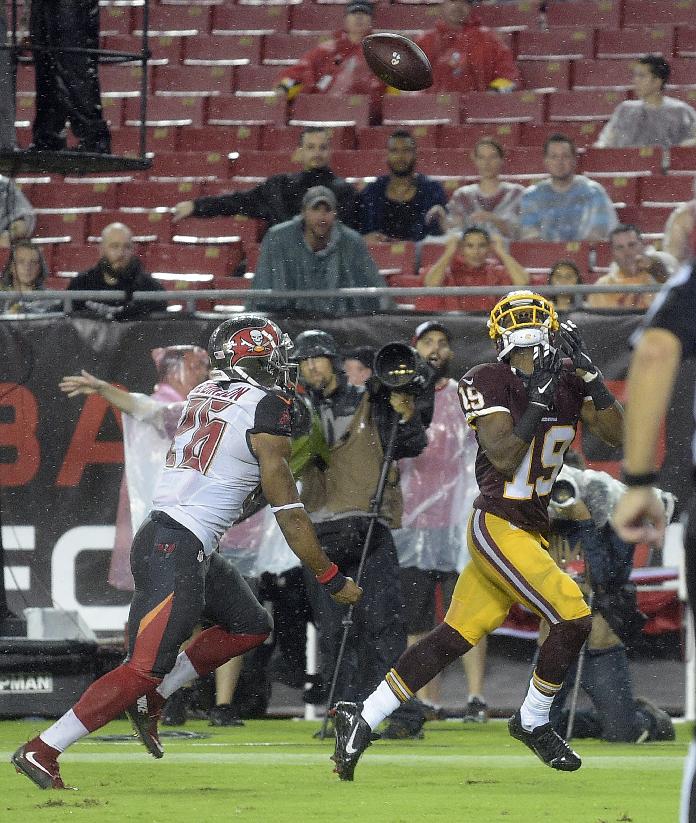 Washington Redskins wide receiver Rashad Ross (19) prepares to pull on a 13-yard touchdown pass after getting past Tampa Bay Buccaneers defensive back Josh Robinson (26) during the third quarter of an NFL preseason football game Wednesday, Aug. 31, 2016,