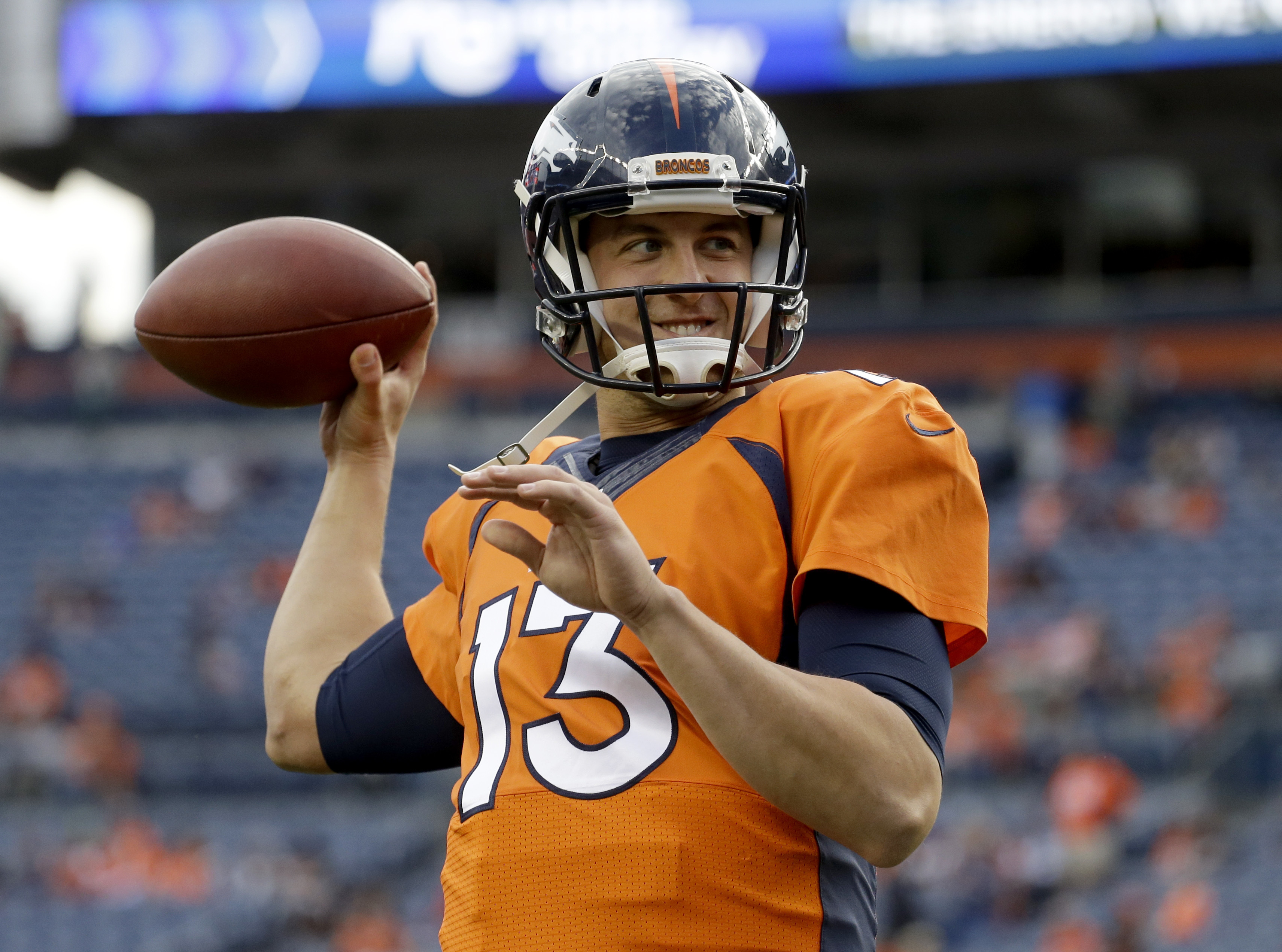 FILE - In this Aug. 27, 2016, file photo, Denver Broncos quarterback Trevor Siemian (13) warms up prior to an NFL preseason football game against the Los Angeles Rams, in Denver. Offseason workouts, training camp and preseason games are supposed to supply