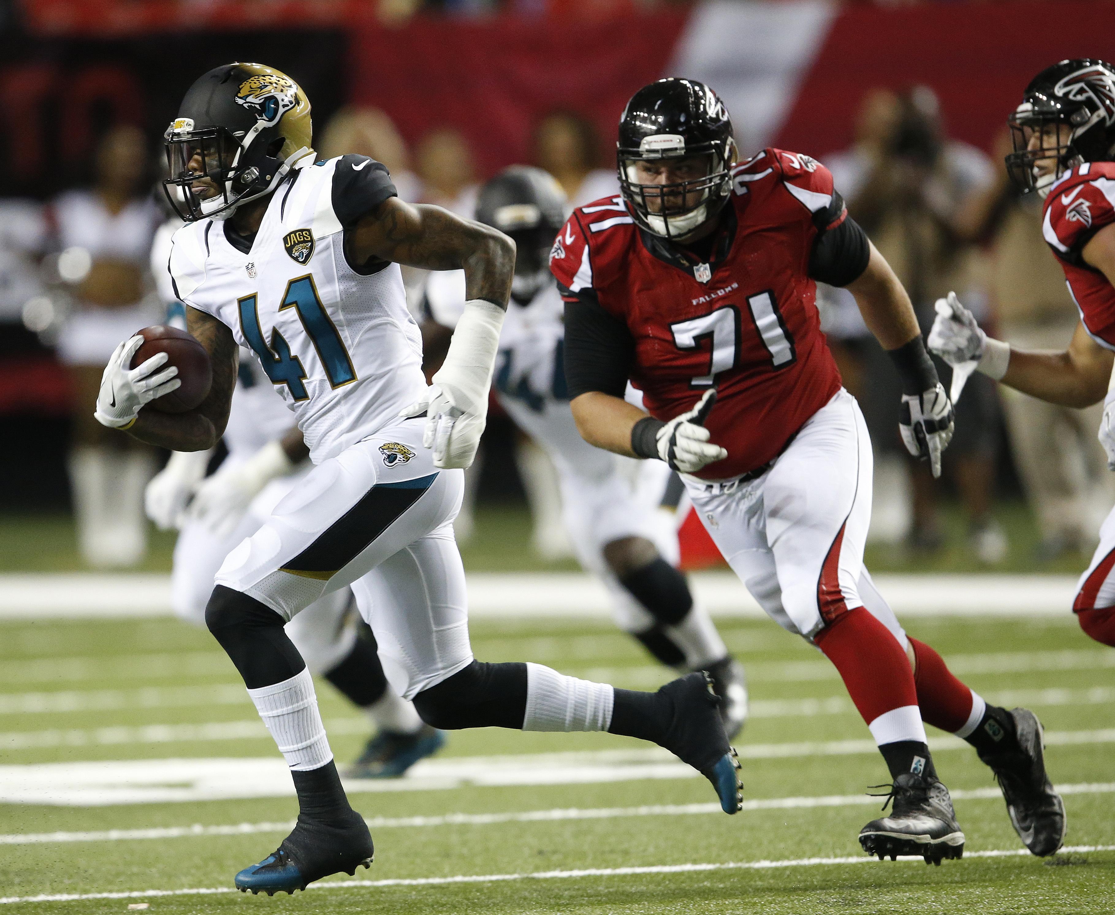Jacksonville Jaguars cornerback Nick Marshall (41) runs past Atlanta Falcons offensive guard Wes Schweitzer (71) during the first half of a preseason NFL football game, Thursday, Sept. 1, 2016, in Atlanta. (AP Photo/John Bazemore)