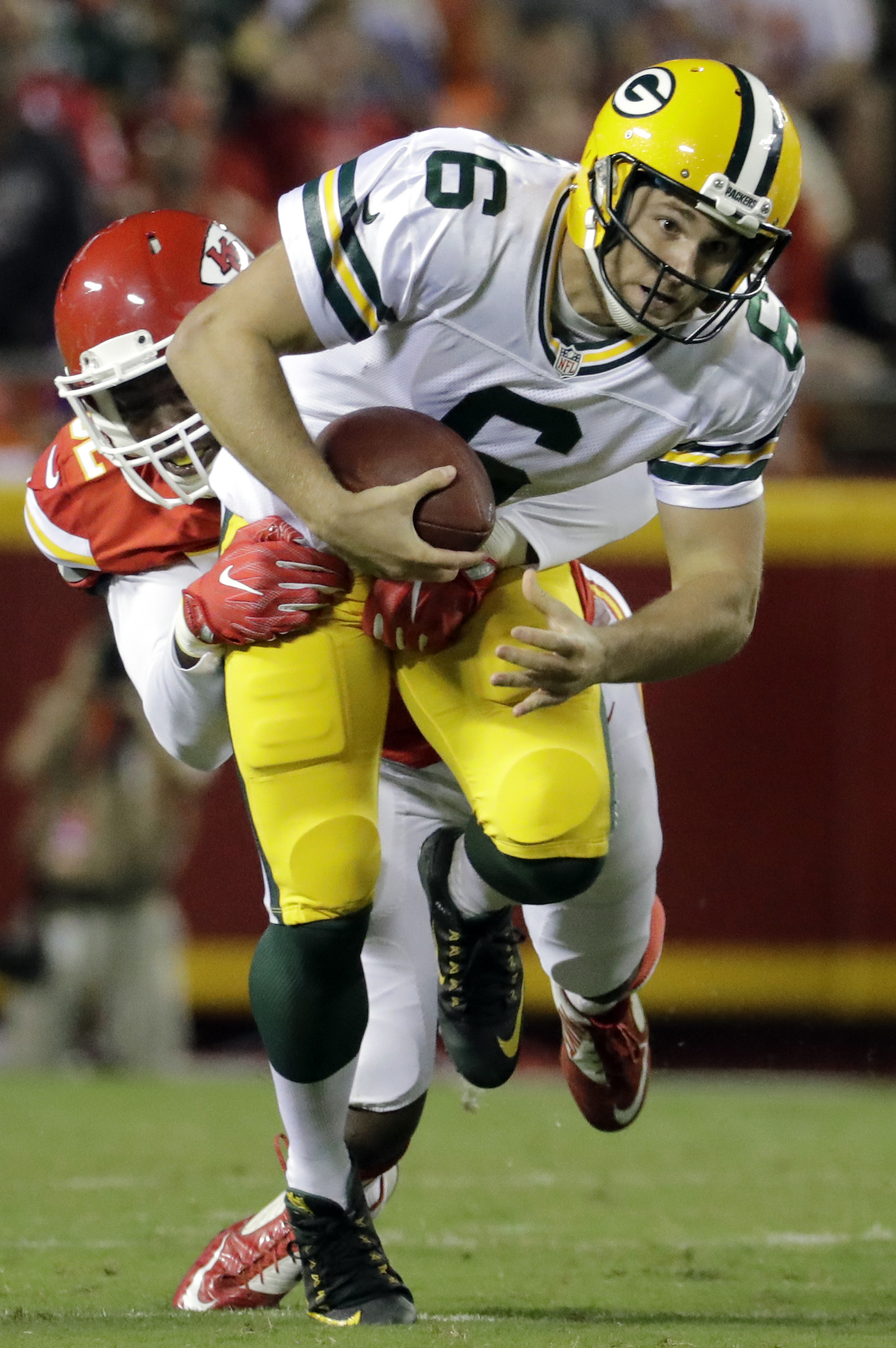 Kansas City Chiefs linebacker Dadi Nicolas, rear, sacks Green Bay Packers quarterback Joe Callahan (6) during the second half of an NFL preseason football game in Kansas City, Mo., Thursday, Sept. 1, 2016. Nicolas was injured on the play. (AP Photo/Charli