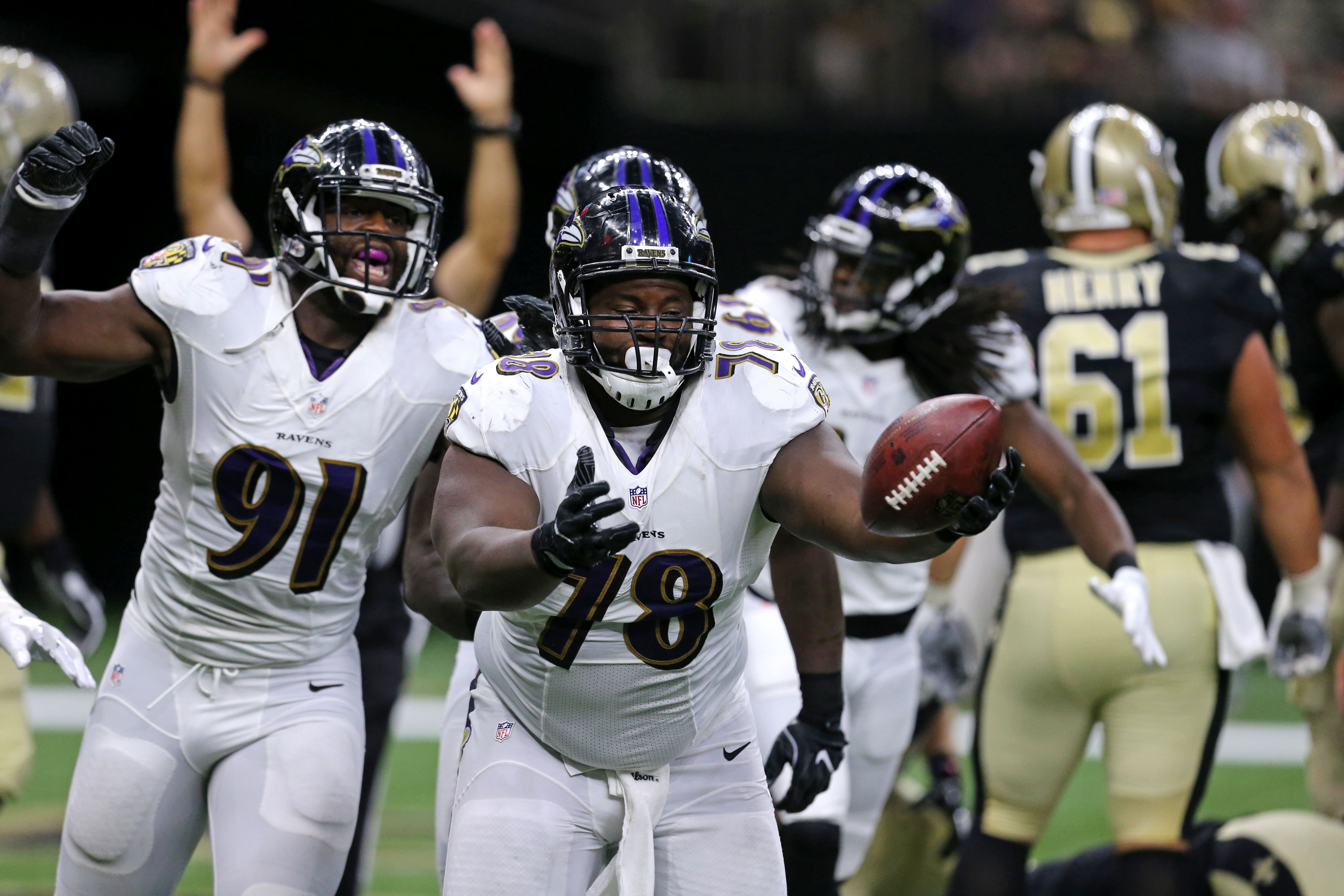 Baltimore Ravens defensive tackle Michael Pierce (78) celebrates after recovering a fumble in the end zone by New Orleans Saints quarterback Drew Brees for a touchdown in the first half of a pre-season NFL football game in New Orleans, Thursday, Sept. 1,