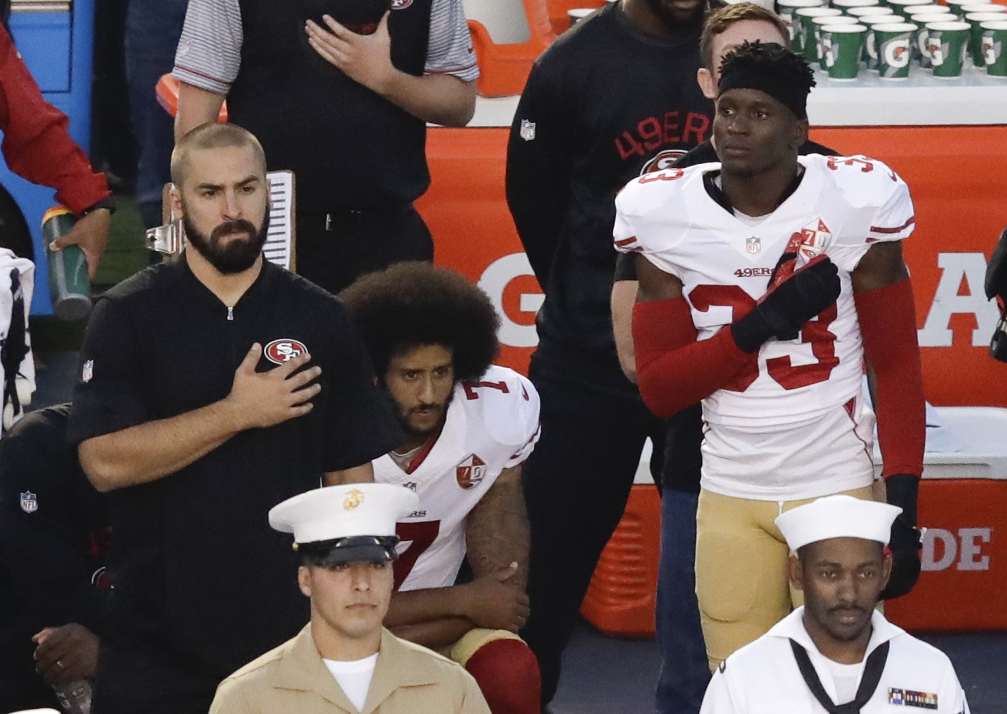FILE - In this Thursday, Sept. 1, 2016 file photo, San Francisco 49ers quarterback Colin Kaepernick, middle, kneels during the national anthem before the team's NFL preseason football game against the San Diego Chargers, in San Diego. The Santa Clara poli
