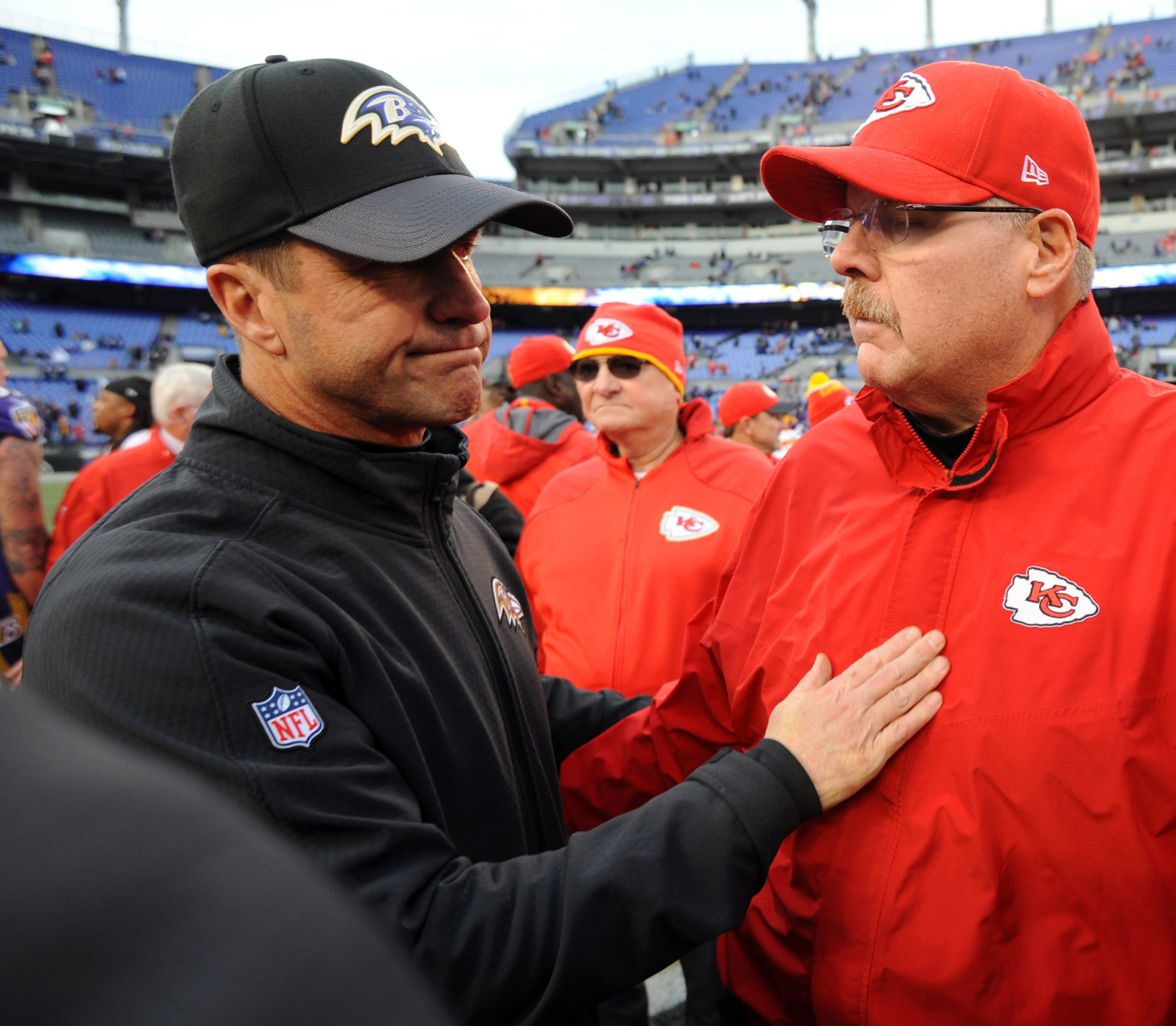 FILE - In this Dec. 20, 2015, file photo, Baltimore Ravens head coach John Harbaugh, left, speaks with Kansas City Chiefs head coach Andy Reid after the Chiefs defeated the Ravens 34-14 in an NFL football game, in Baltimore. If Baltimore is to again becom