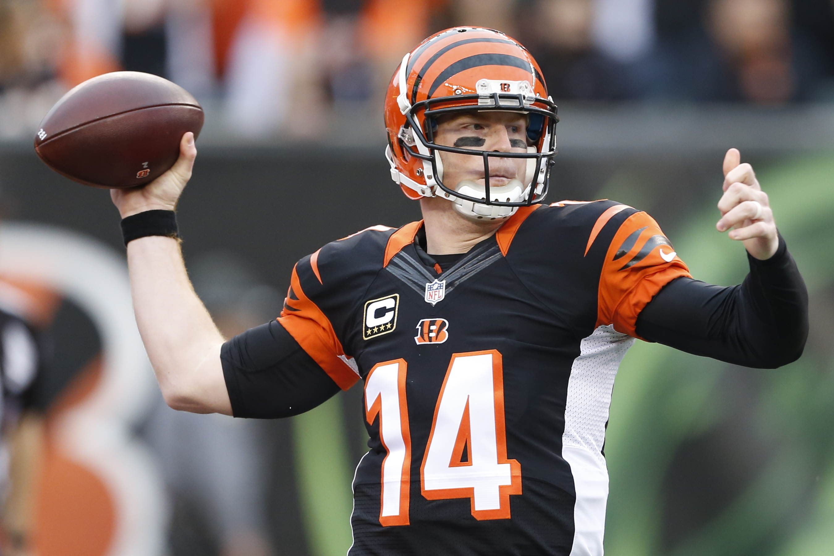 FILE - In this Dec. 13, 2015 file photo, Cincinnati Bengals quarterback Andy Dalton throws in the first half of an NFL football game against the Pittsburgh Steelers in Cincinnati. Andy Dalton had his breakout season, leading the AFC in passer rating befor