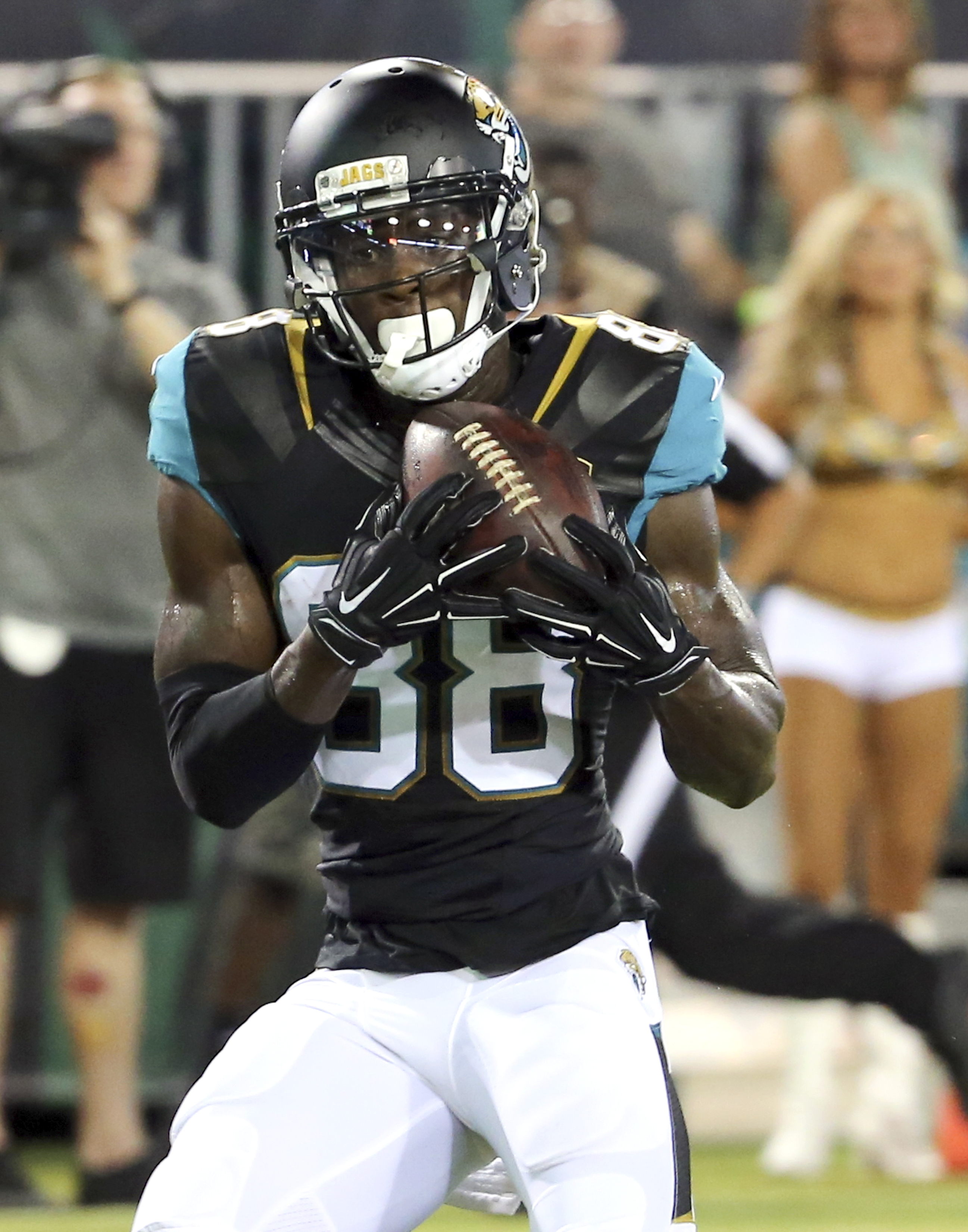 FILE - In this Aug. 20, 2016, file photo, Jacksonville Jaguars wide receiver Allen Hurns (88) makes a catch for a 24-yard touchdown against the Tampa Bay Buccaneers during the first half of an NFL preseason football game in Jacksonville, Fla. Hurns and Al