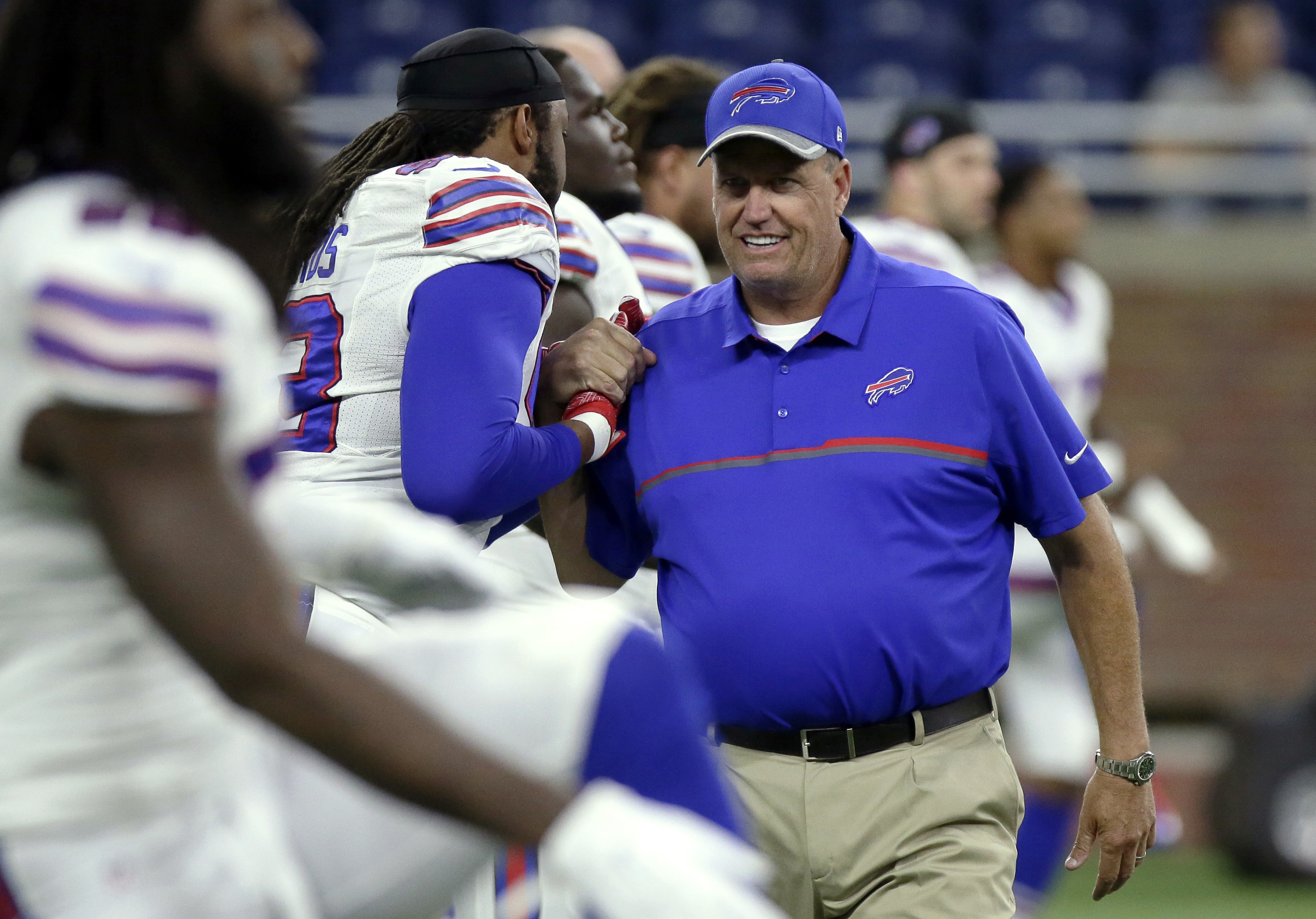 FILE - In this Sept. 1, 2016, file photo, Buffalo Bills coach Rex Ryan talks to players before the team's NFL preseason football game against the Detroit Lions in Detroit. Despite injuries, Ryan insists his defense will be improved from last year, when it