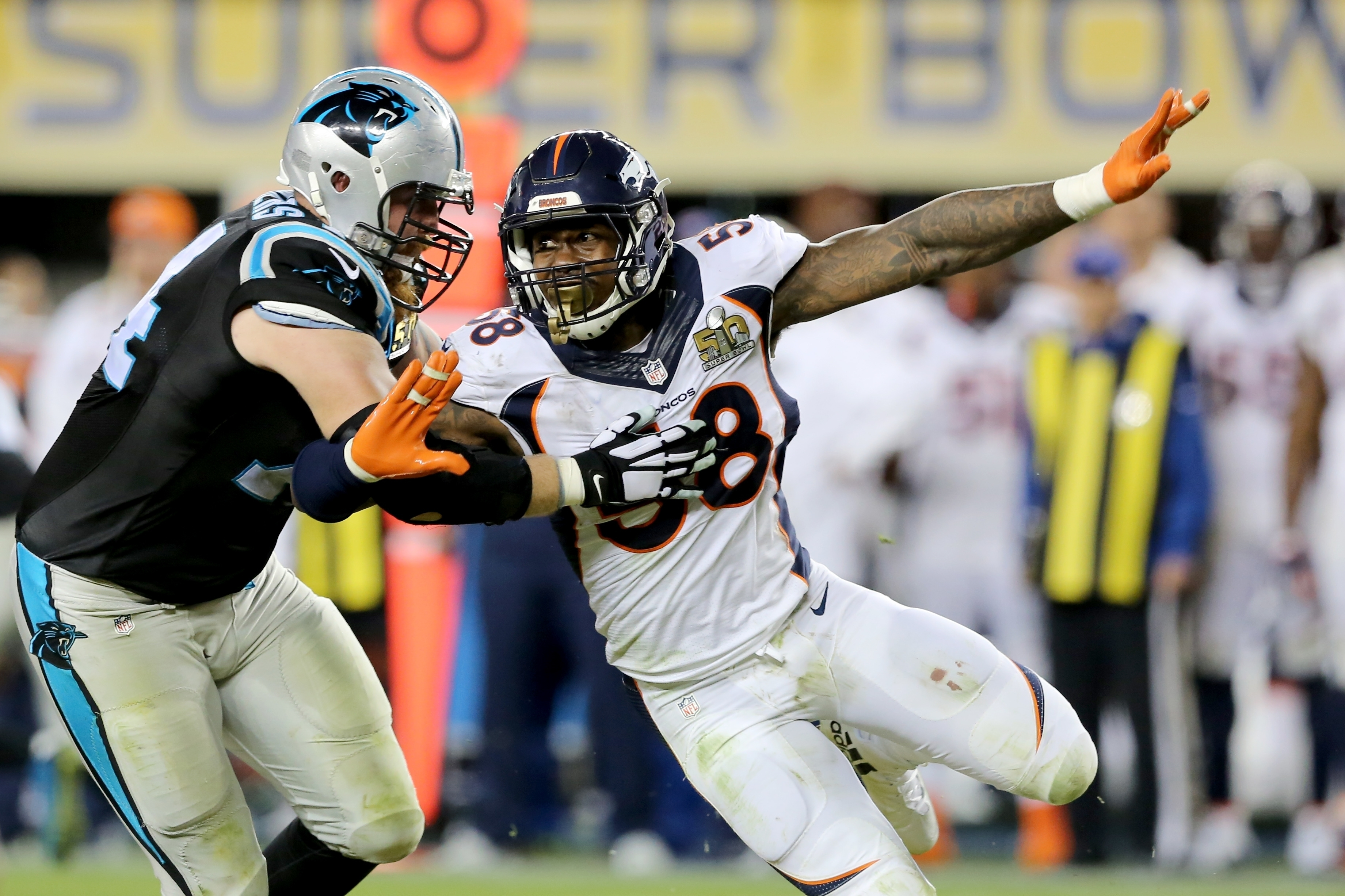 FILE - In this Sunday, Feb. 7, 2016, file photo, Denver Bronco's Von Miller (58) makes an outside rush against the Carolina Panthers' Mike Remmers (74) during the NFL Super Bowl 50 football game in Santa Clara, Calif. Super Bowl MVP Von Miller, who transf