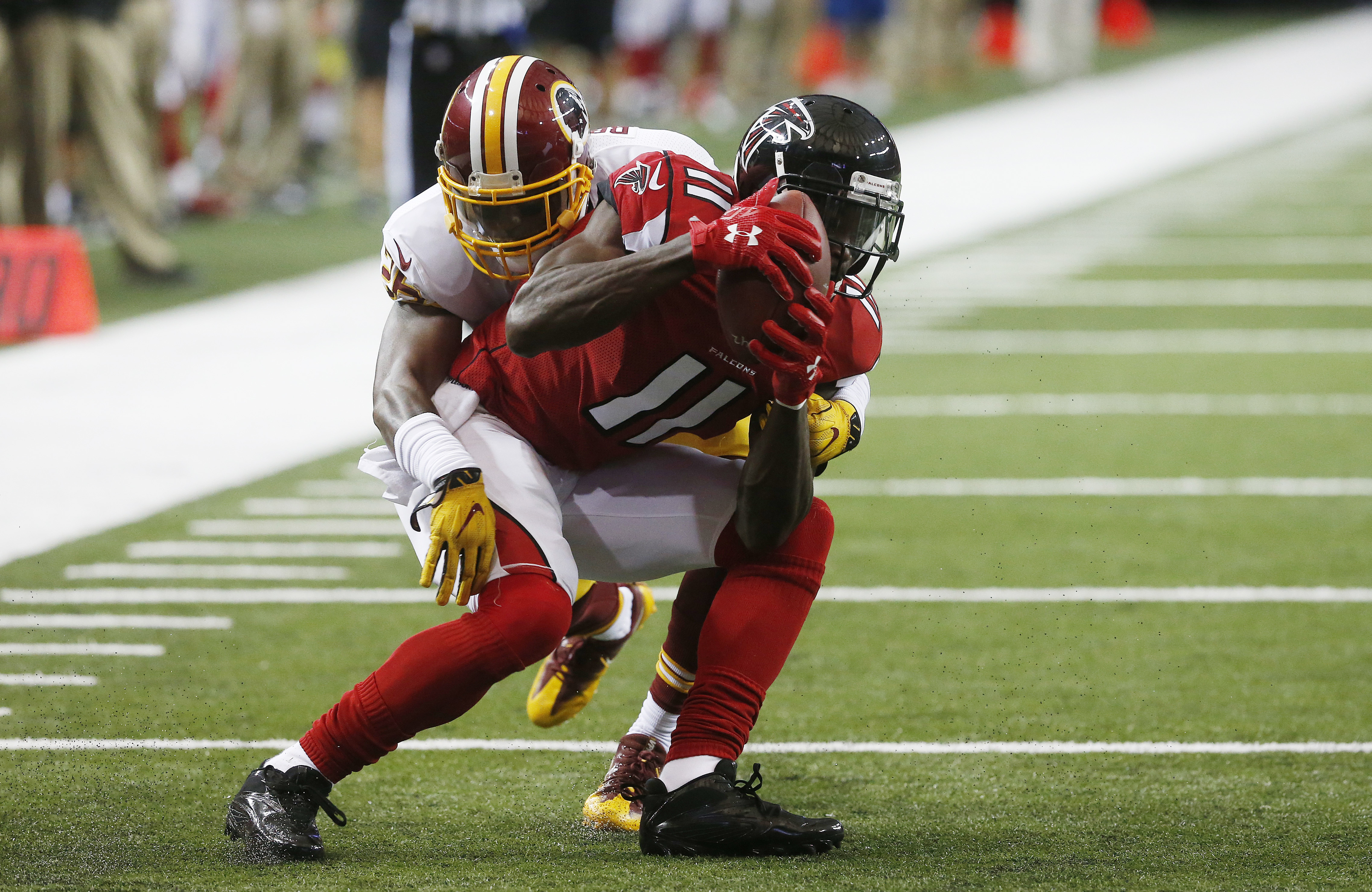 FILE - In this Aug. 11, 2016, file photo, Atlanta Falcons wide receiver Julio Jones (11) makes the catch against Washington Redskins cornerback Bashaud Breeland (26) during the first half of a preseason NFL football game in Atlanta. All-Pro receiver Julio