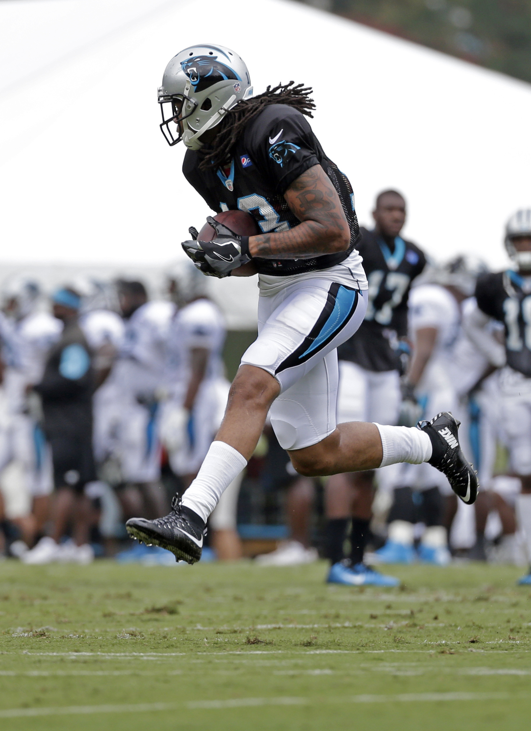 FILE - In this Aug. 8, 2016, file photo, Carolina Panthers' Kelvin Benjamin catches a pass during an NFL training camp practice in Spartanburg, S.C. Cam Newton became an NFL Most Valuable Player and led his team to the Super Bowl last season without the s