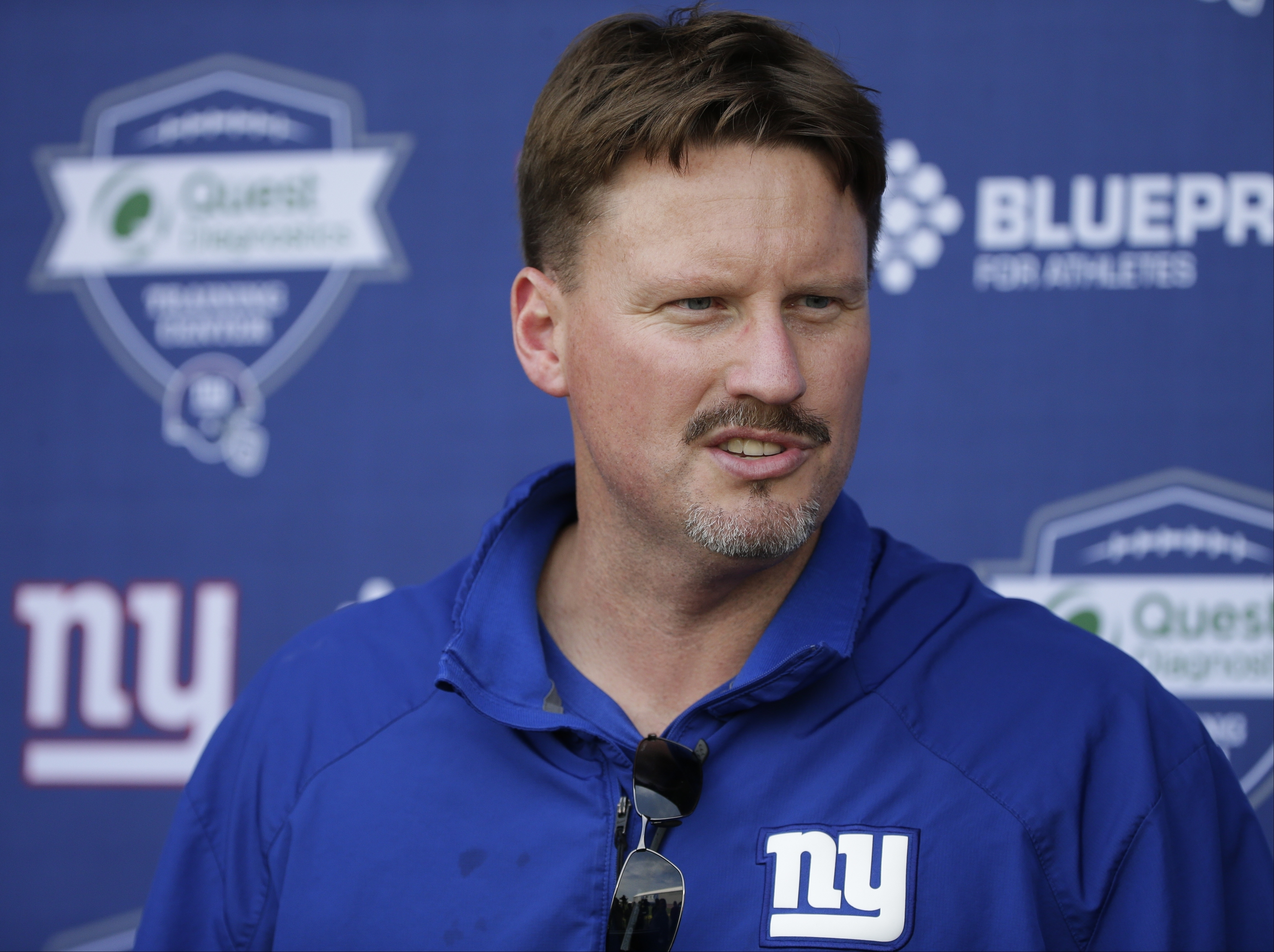 FILE - In this June 1, 2016, file photo, New York Giants head coach Ben McAdoo speaks during a news conference at the New York Giants training facility in East Rutherford, N.J. McAdoo has done and said all the right things since being hired to replace Cou