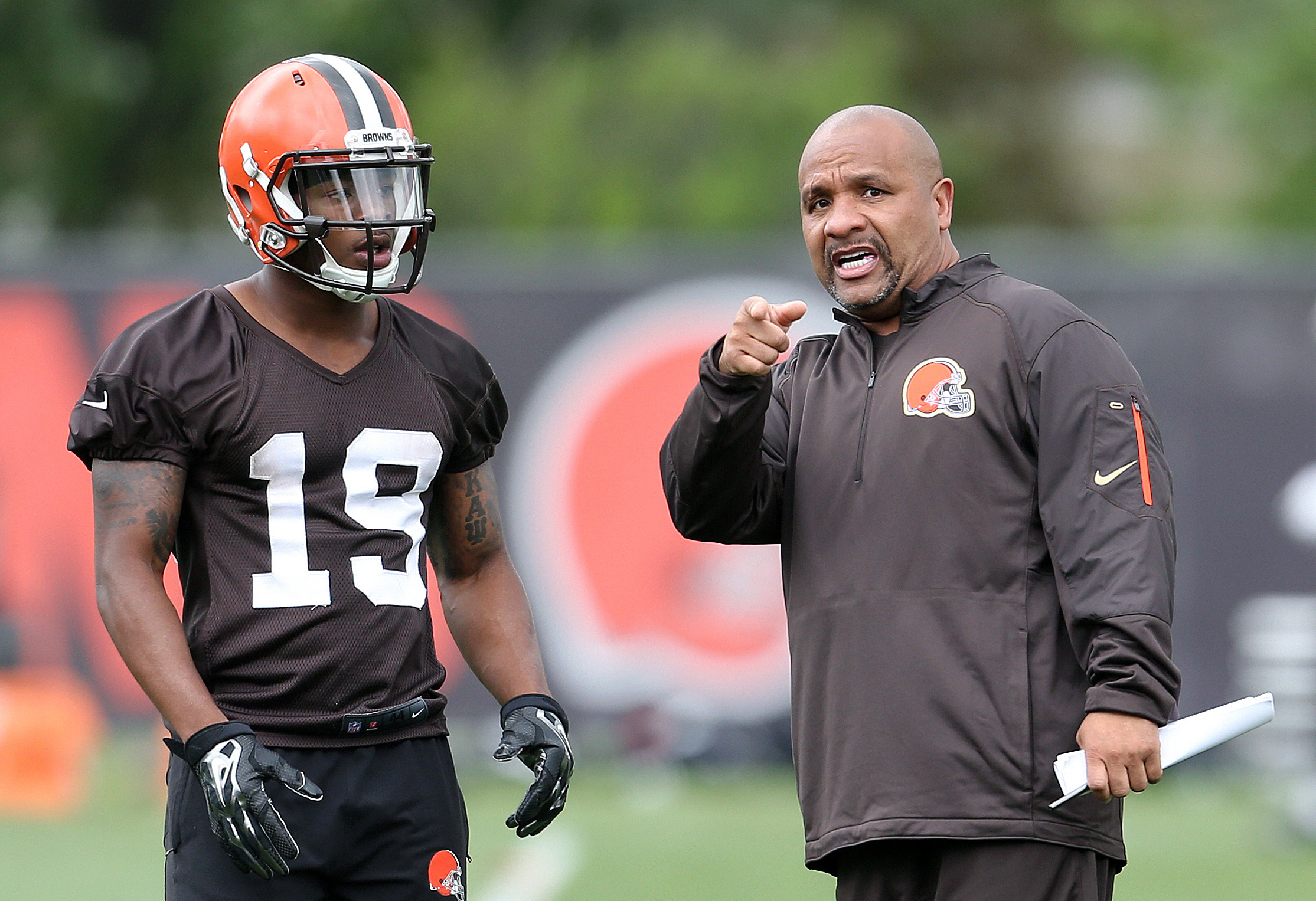 FILE - In this June 7, 2016, file photo, Cleveland Browns head coach Hue Jackson, right, gives directions to Cleveland Browns wide receiver Corey Coleman during NFL football mini camp at the practice facility,in Berea, Ohio. Cleveland will open the season