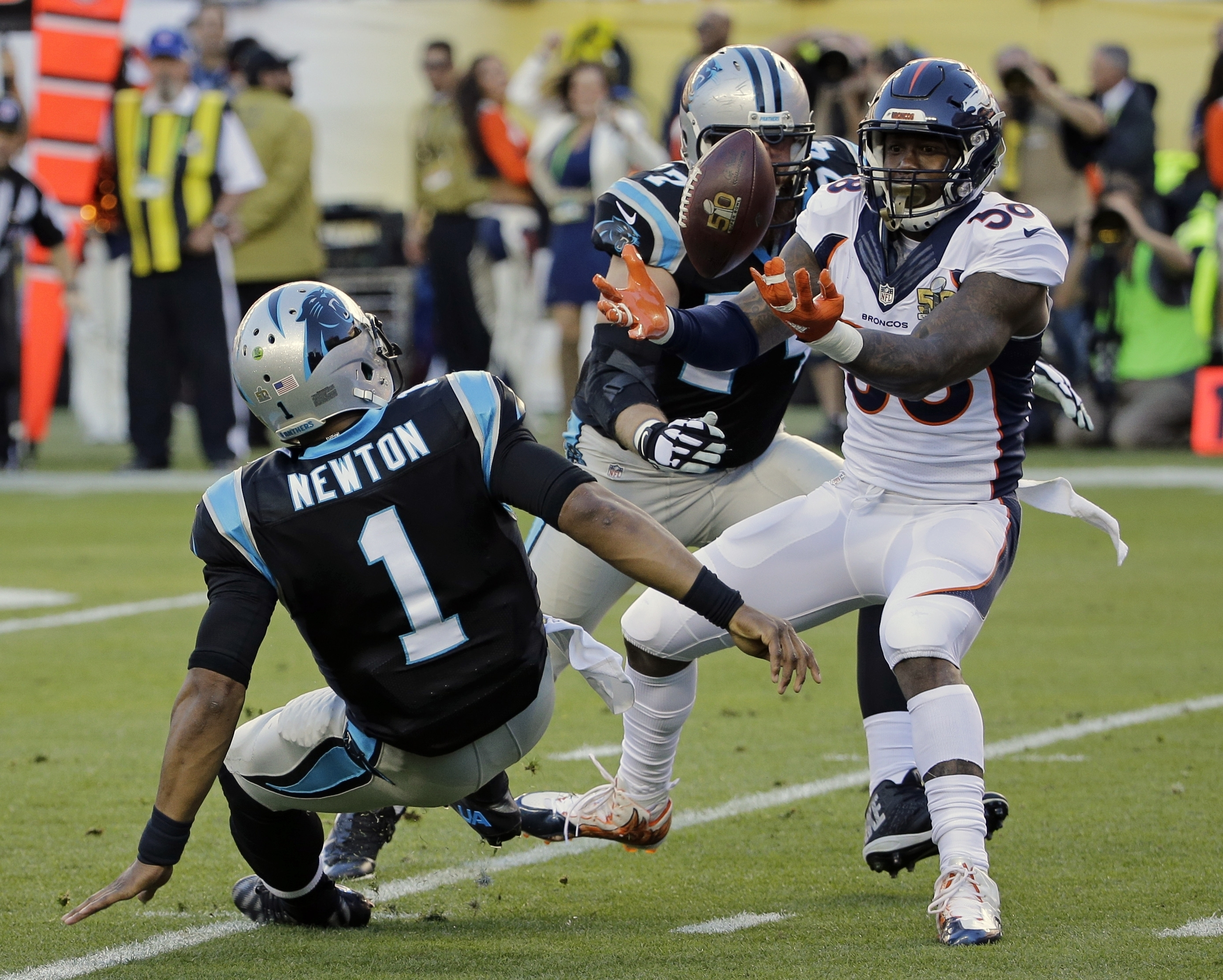 FILE - In this Feb. 7, 2016, file photo, Denver Broncos' Von Miller (58) strips the ball from Carolina Panthers' Cam Newton (1) during the first half of the NFL Super Bowl 50 football game, in Santa Clara, Calif. Von Miller got the best of Cam Newton both