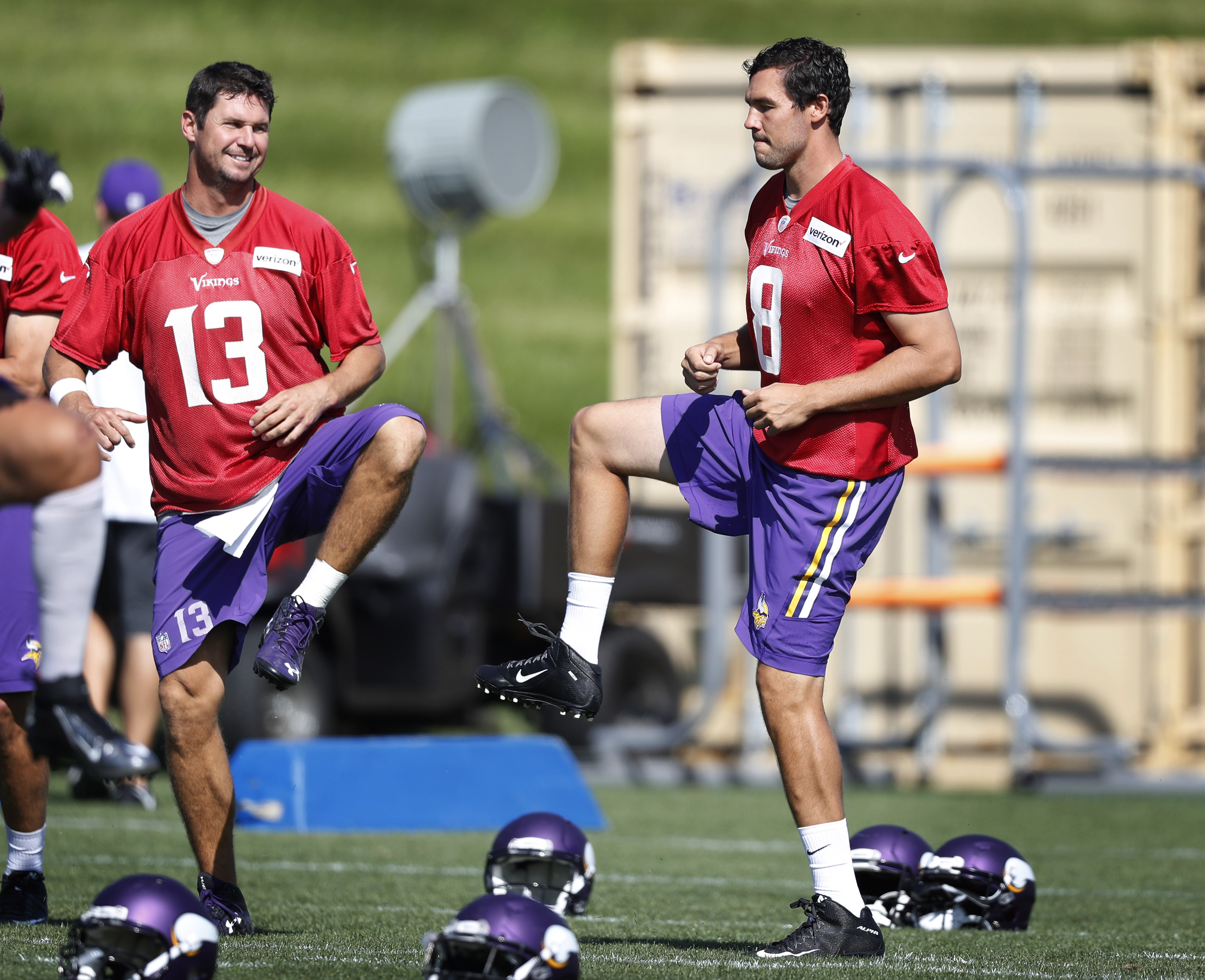 Minnesota Vikings quarterbacks Shaun Hill, left, and Sam Bradford warm up during practice Monday Sept. 5, 2016, in Eden Prairie, Minn. The Philadelphia Eagles traded Bradford to the Vikings on Saturday, for a pair of draft picks. (Jerry Holt/Star Tribune