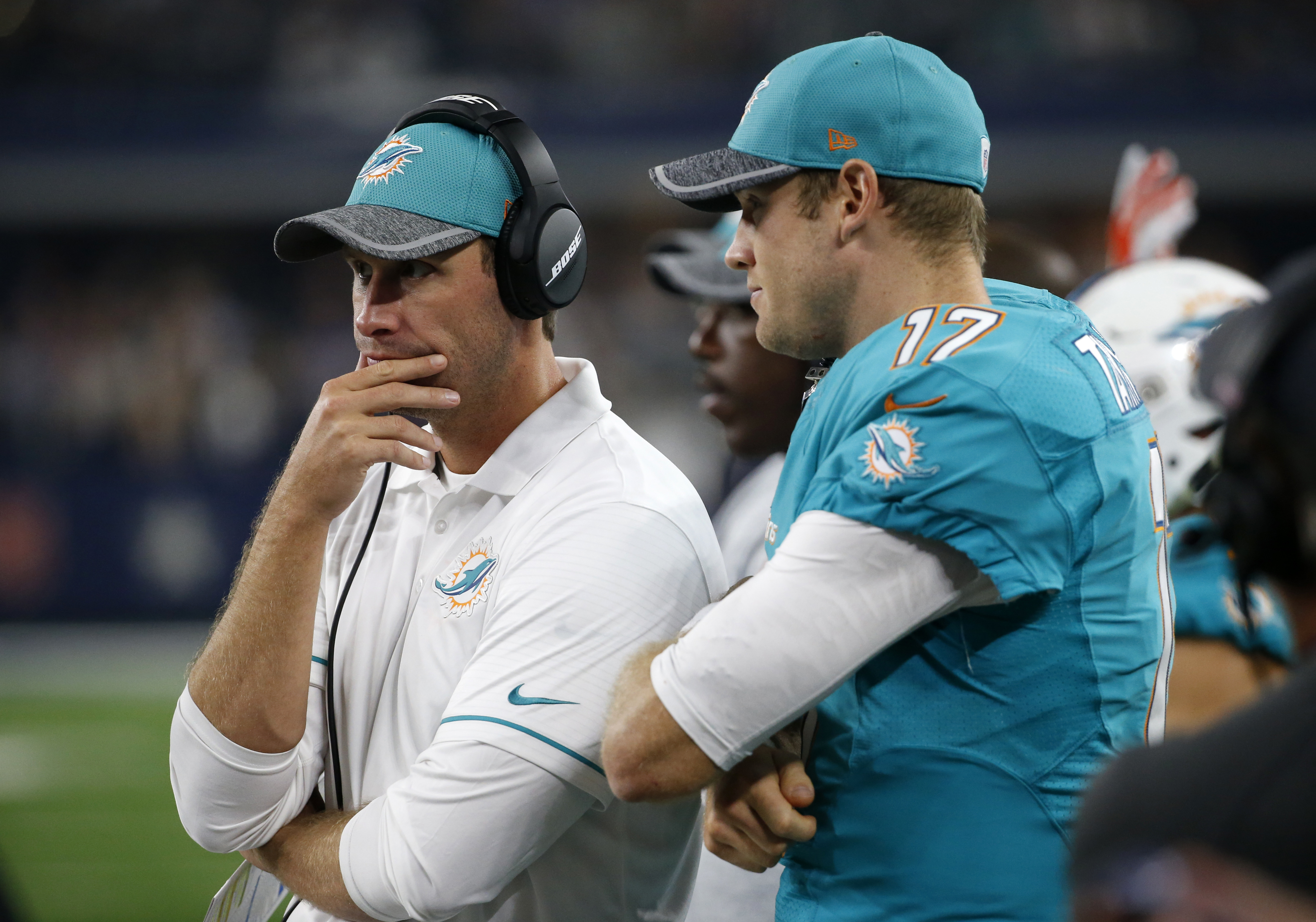 FILE- In this Aug. 19, 2016, file photo, Miami Dolphins head coach Adam Gase, left, stands on the sideline with quarterback Ryan Tannehill in the second half of an NFL preseason football game against the Dallas Cowboys in Arlington, Texas. New Miami Dolph