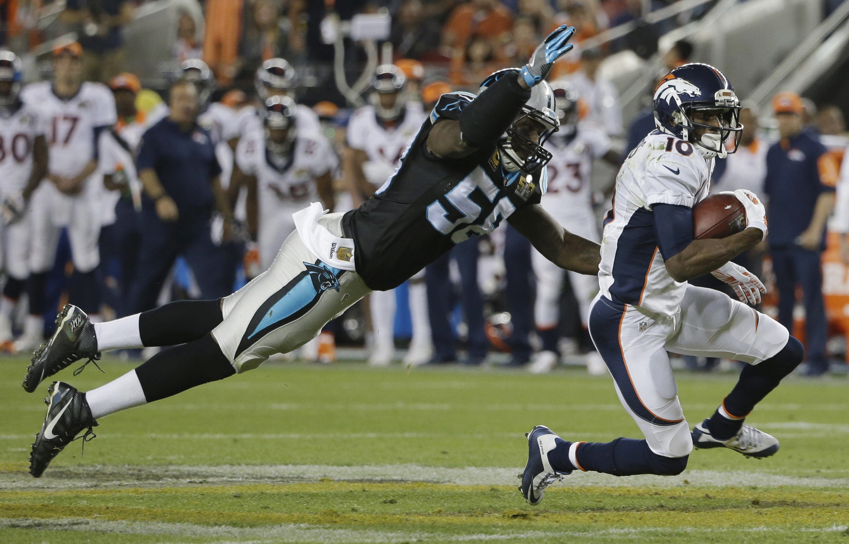 FILE - In this Feb. 7, 2016, file photo, Carolina Panthers' Thomas Davis (58) dives for Denver Broncos' Emmanuel Sanders (10) during the second half of the NFL Super Bowl 50 football game, in Santa Clara, Calif. Panthers linebacker Thomas Davis, entering
