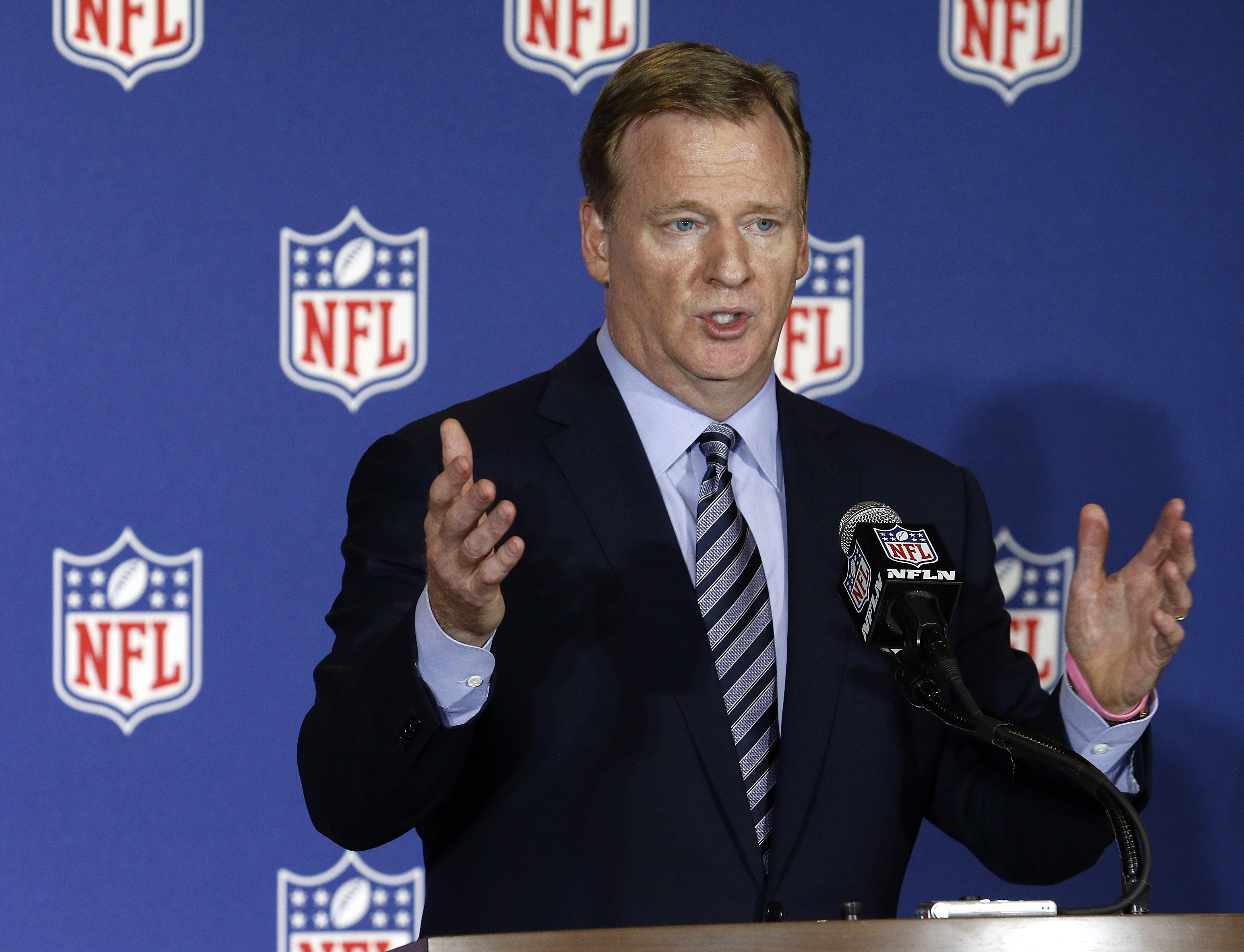 FILE - In this May 24, 2016, file photo, NFL commissioner Roger Goodell answers reporter's questions at an NFL owner's meeting in Charlotte N.C.  Goodell disagrees with Colin Kaepernick's choice to kneel during the national anthem, but recognizes the quar