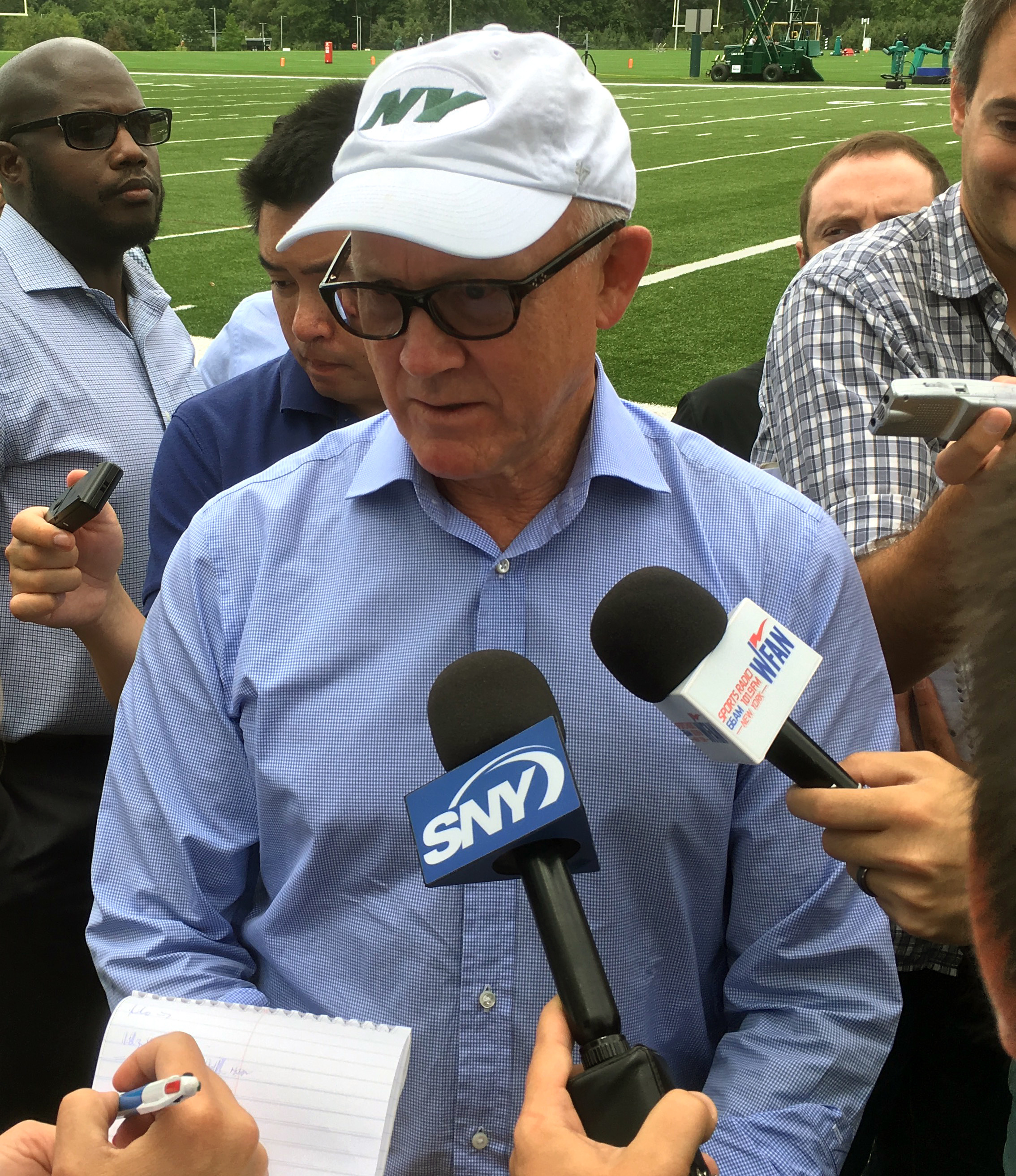 New York Jets NFL football team owner Woody Johnson speaks to reporters before a team practice in Florham Park, N.J., Wednesday, Sept. 7, 2016. Woody Johnson says the team's goal is to reach the playoffs every year, but declined to say that this season wo