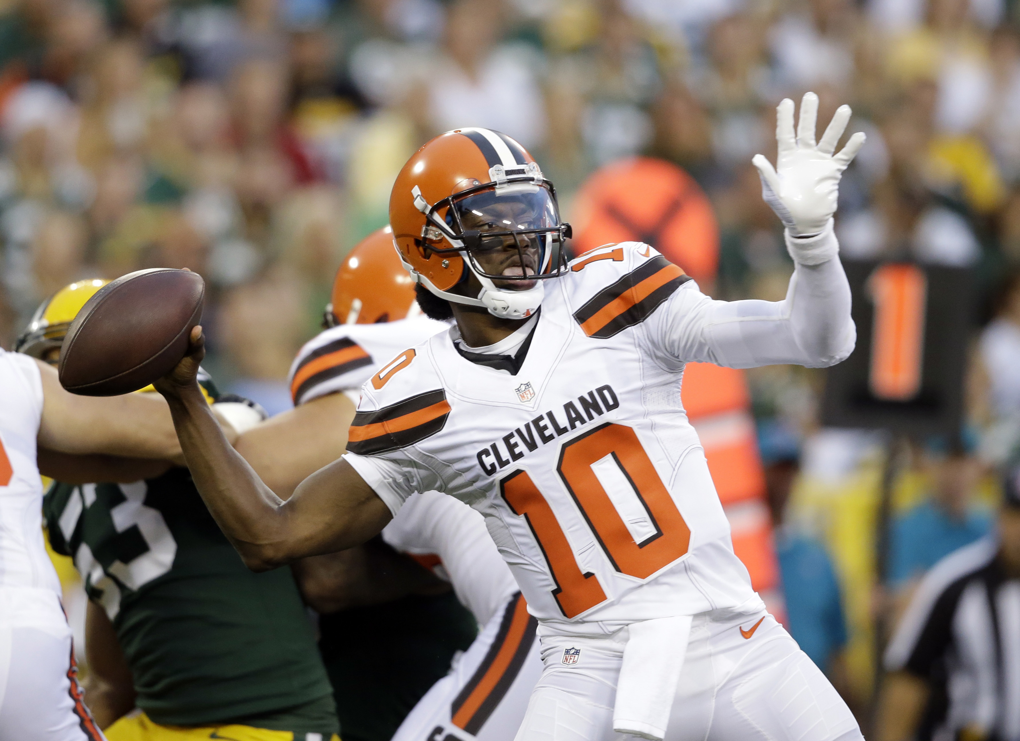FILE - In this Aug. 12, 2016, file photo, Cleveland Browns quarterback Robert Griffin III (10) throws against the Green Bay Packers in the first half of an NFL preseason football game in Green Bay, Wis. Maybe no longer the dual threat he was as a rookie f