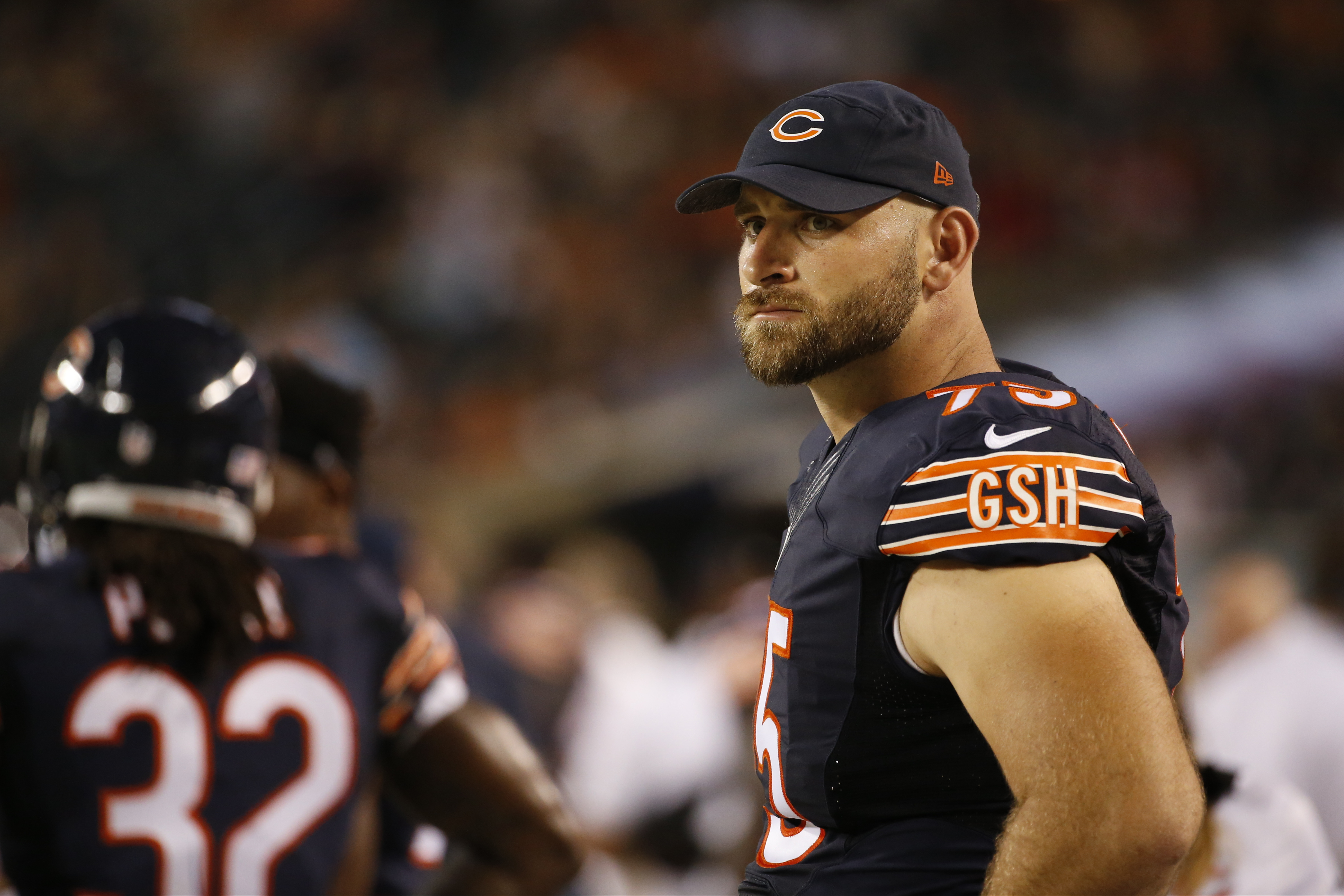 FILE - In this Aug. 11, 2016, file photo, Bears offensive tackle Kyle Long watches during the second half of an NFL preseason football game against the Denver Broncos in Chicago.  The Bears signed three-time Pro Bowl offensive lineman to a four-year contr
