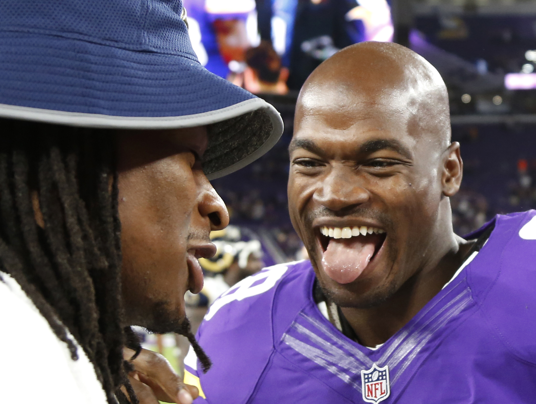 FILE - In this Sept. 1, 2016, file photo, Minnesota Vikings running back Adrian Peterson, right, talks with Los Angeles Rams running back Todd Gurley, left, after an NFL preseason football game, in Minneapolis. Peterson can hardly sleep, so eager for the