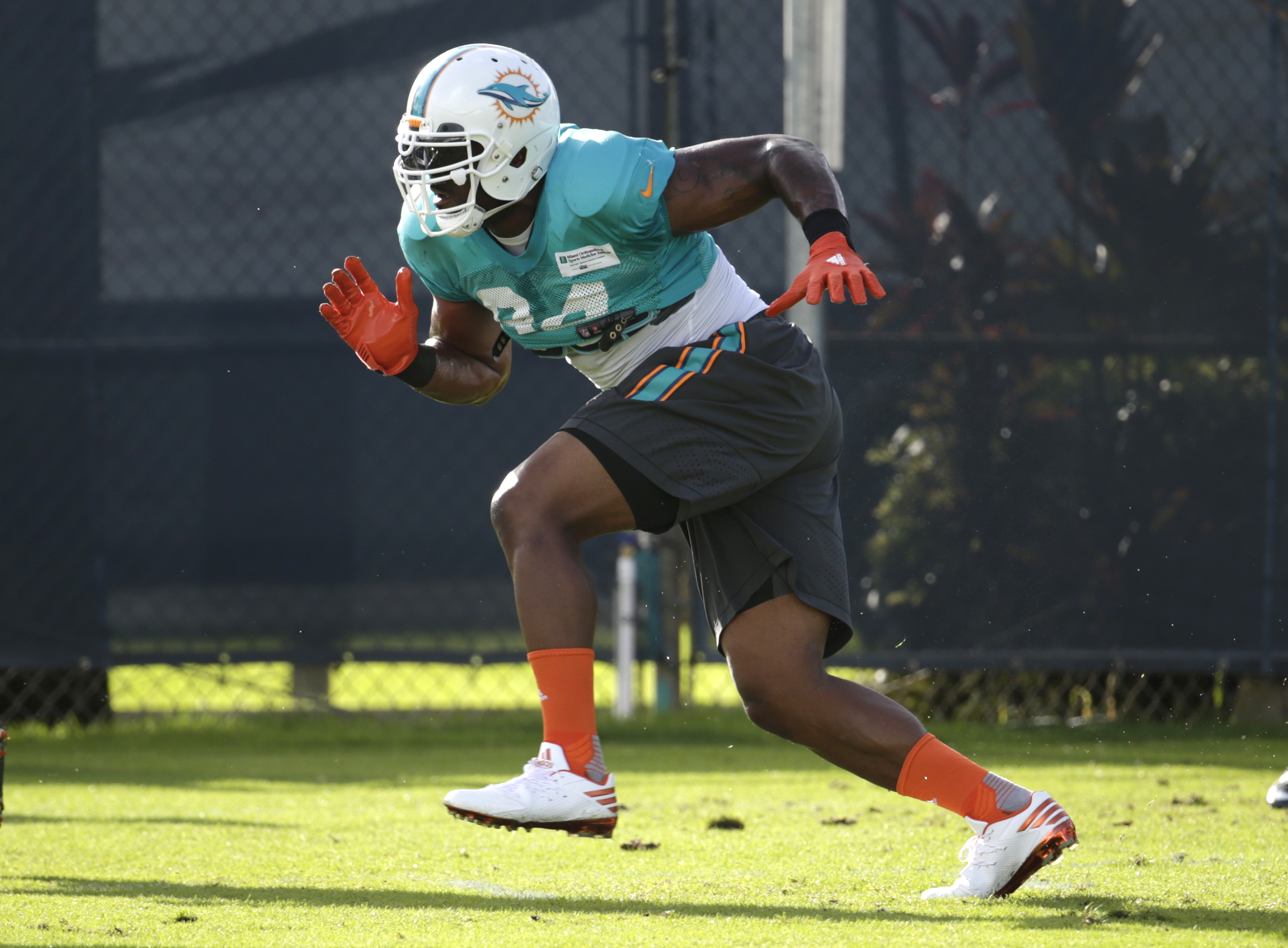 FILE - In this Aug. 15, 2016 file photo, Miami Dolphins defensive end Mario Williams runs drills, during practice at NFL football training camp in Davie, Fla. Williams makes in his debut with Miami on Sunday, Sept. 11 when the Dolphins play the the Seattl