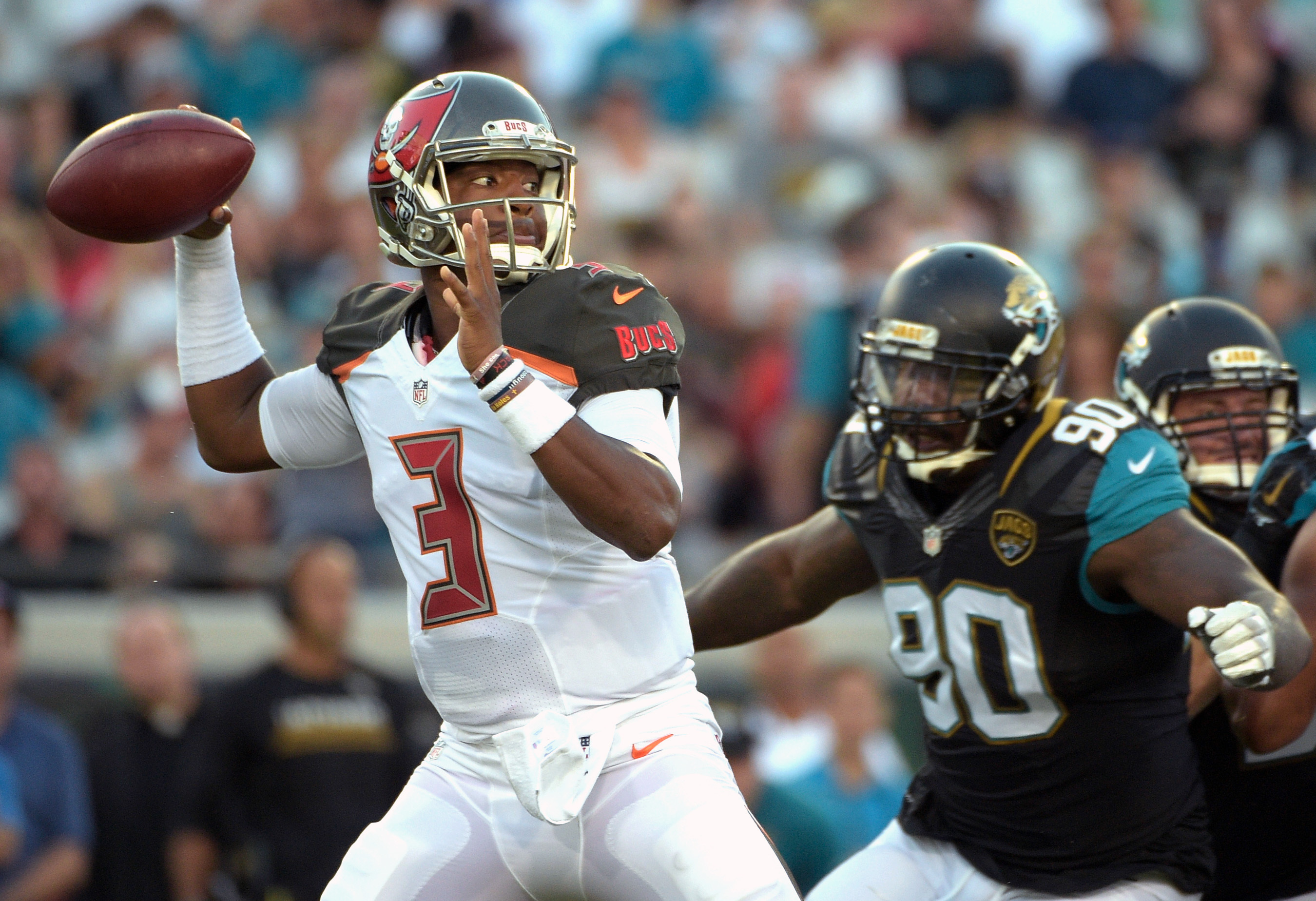 FILE - In this Aug. 20, 2016, file photo, Tampa Bay Buccaneers quarterback Jameis Winston (3) throws a pass as he is pressured by Jacksonville Jaguars defensive tackle Malik Jackson (90) during the first half of an NFL preseason football game in Jacksonvi