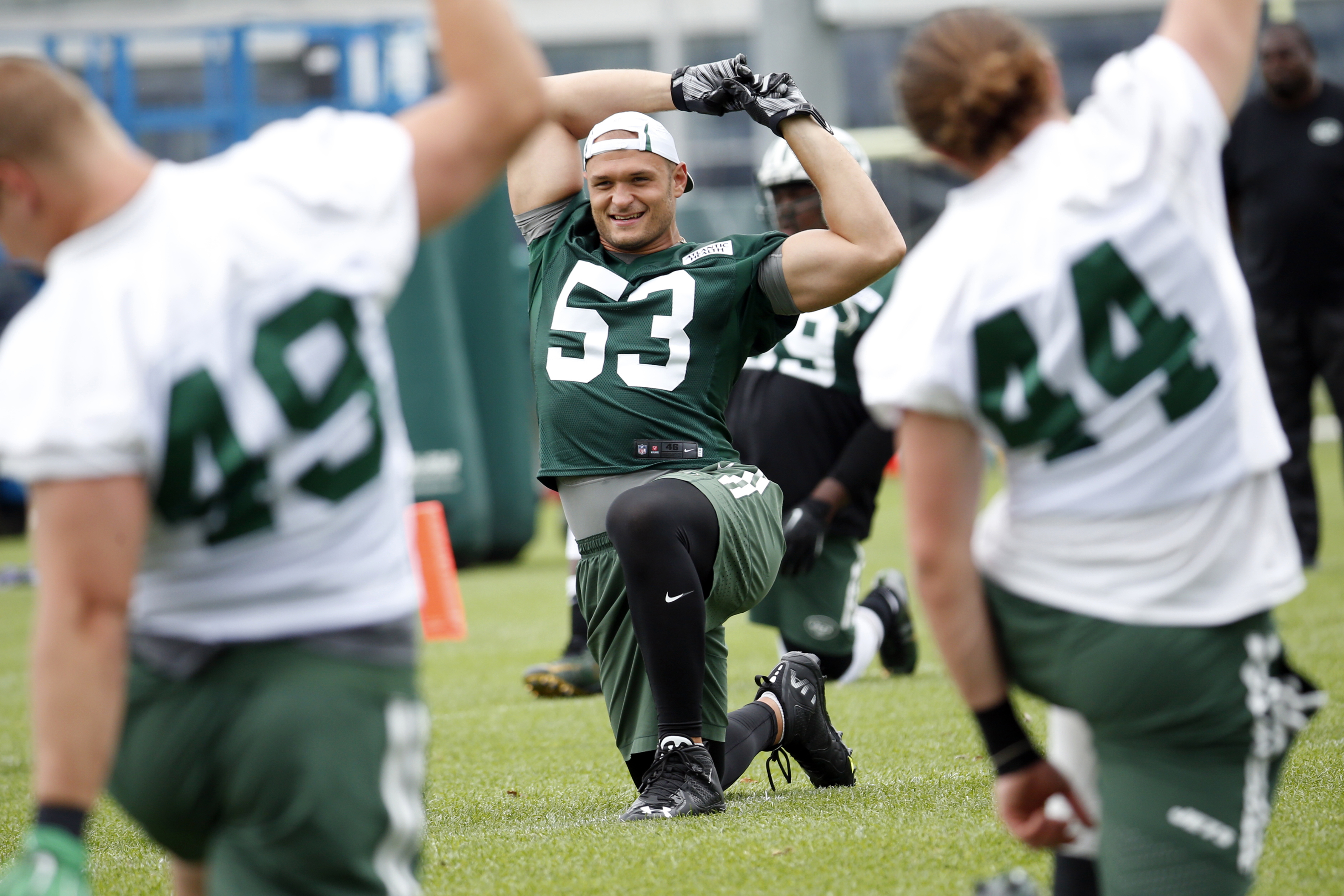 FILE - In this Wednesday, June 8, 2016 photo, New York Jets defensive end Mike Catapano stretches during NFL football practice in Florham Park, N.J. New York Jets' Mike Catapano, a New Yorker, vividly recalls 9/11 attacks. On the 15-year anniversary of th