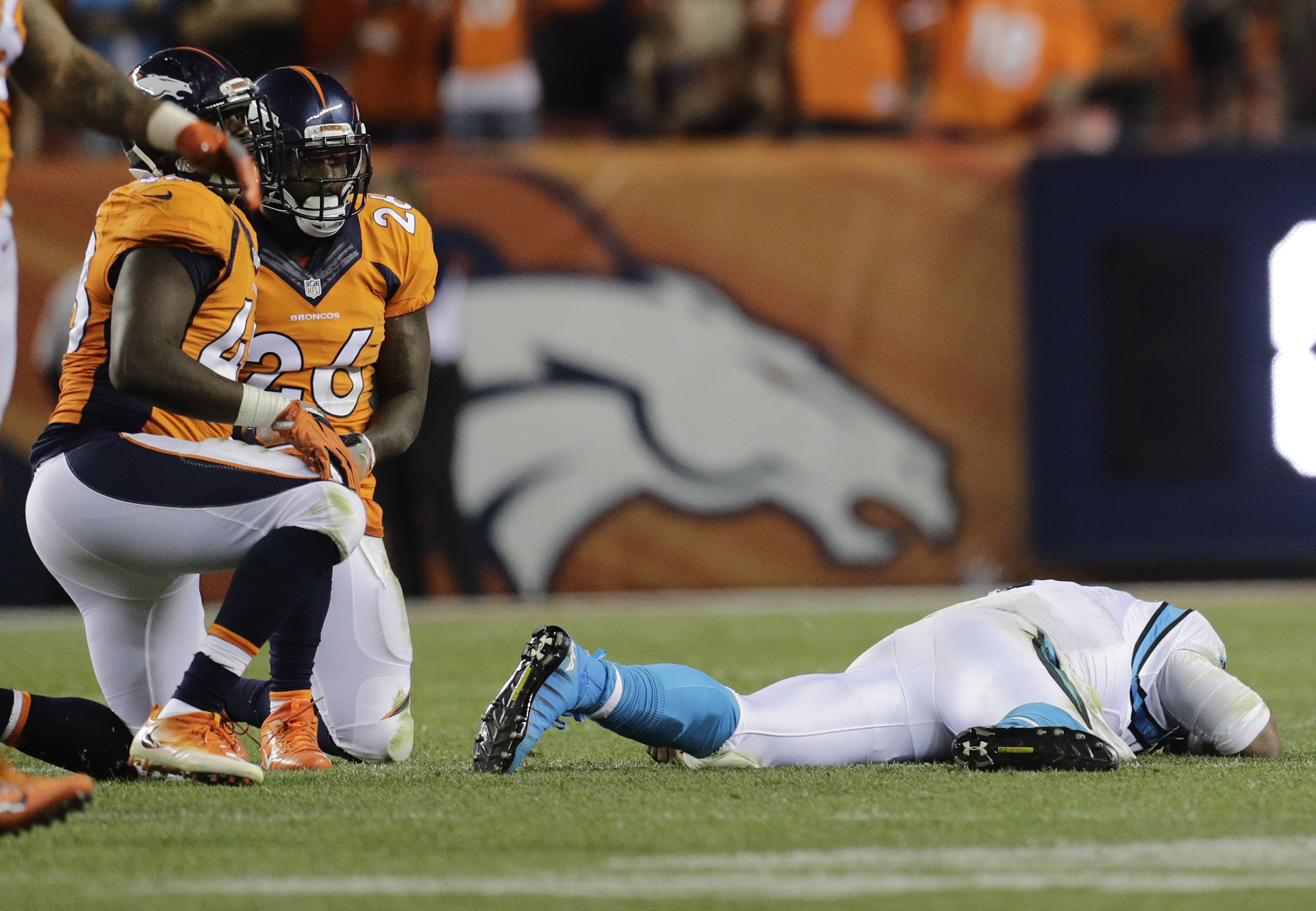 Carolina Panthers quarterback Cam Newton (1) lies on the turf after a roughing the passer penalty on Denver Broncos free safety Darian Stewart (26) during the second half of an NFL football game, Thursday, Sept. 8, 2016, in Denver. The Broncos won 21-20.