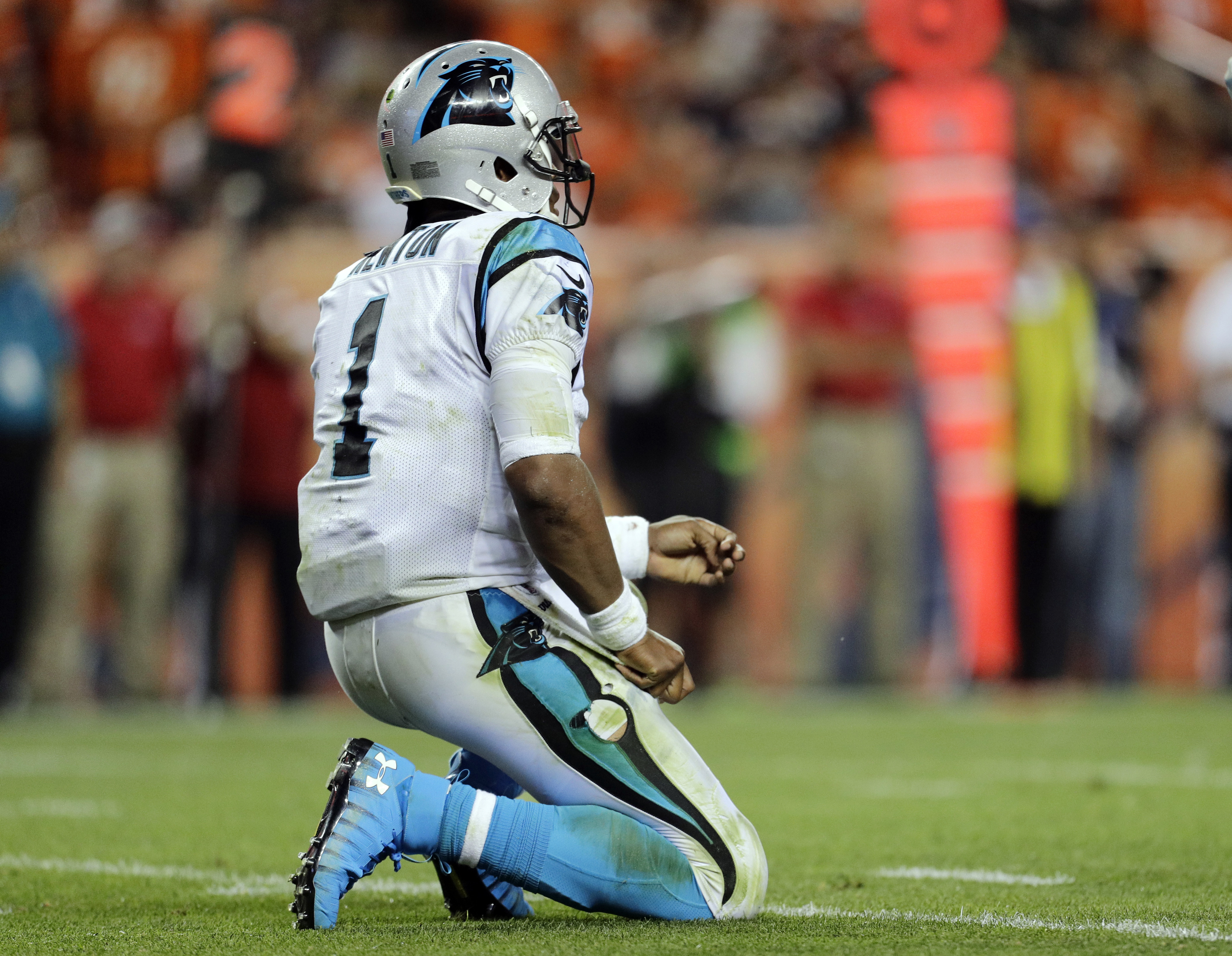 FILE - Thursday, Sept. 8, 2016, file photo, Carolina Panthers quarterback Cam Newton (1) takes a knee after being hit against the Denver Broncos during the second half of an NFL football game in Denver. (AP Photo/Joe Mahoney, File)