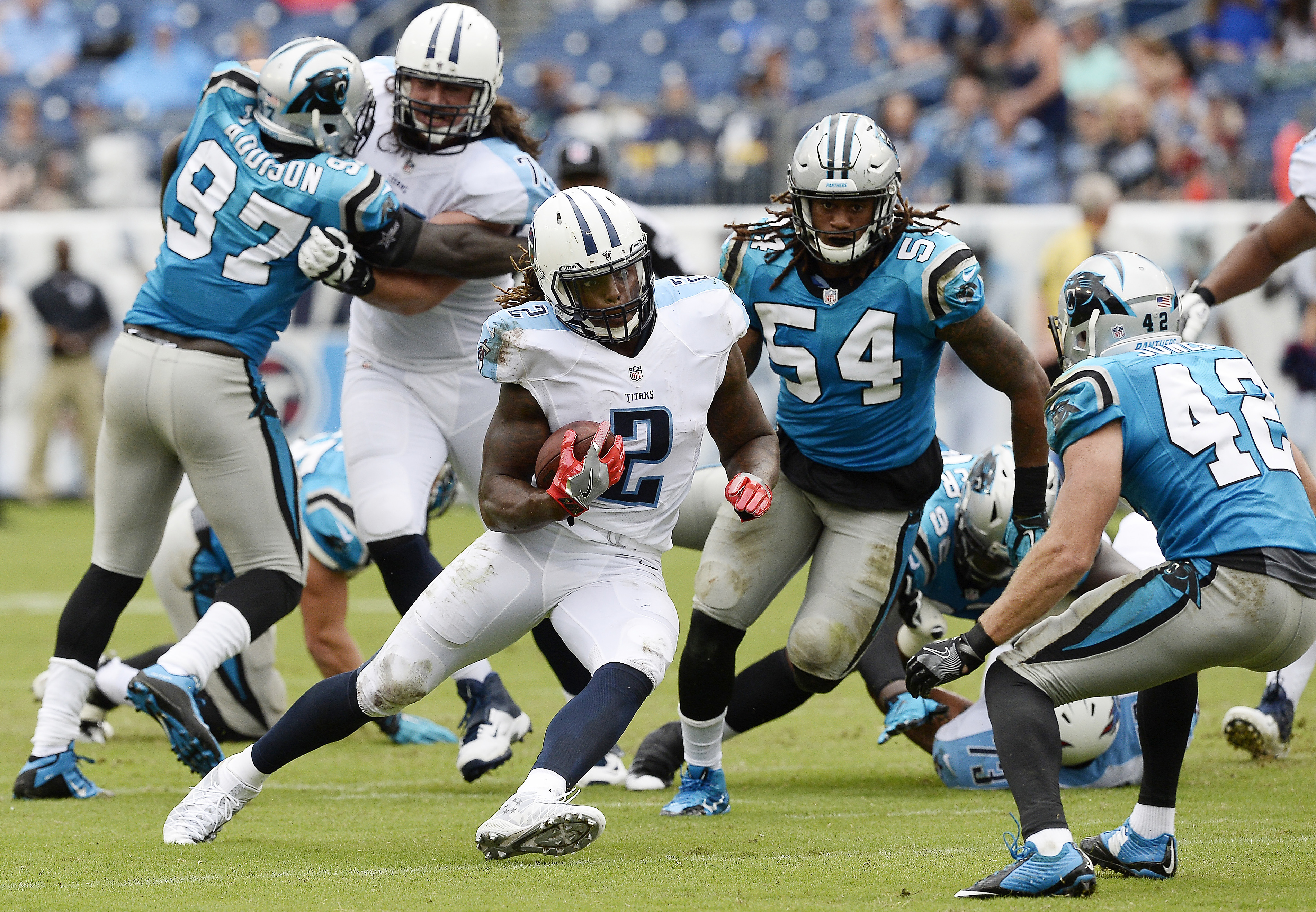 FILE - In this Aug. 20, 2016, file photo, Tennessee Titans running back Derrick Henry (2) runs against the Carolina Panthers during the second half of an NFL preseason football game in Nashville, Tenn. Henry finally has settled on a number for the regular