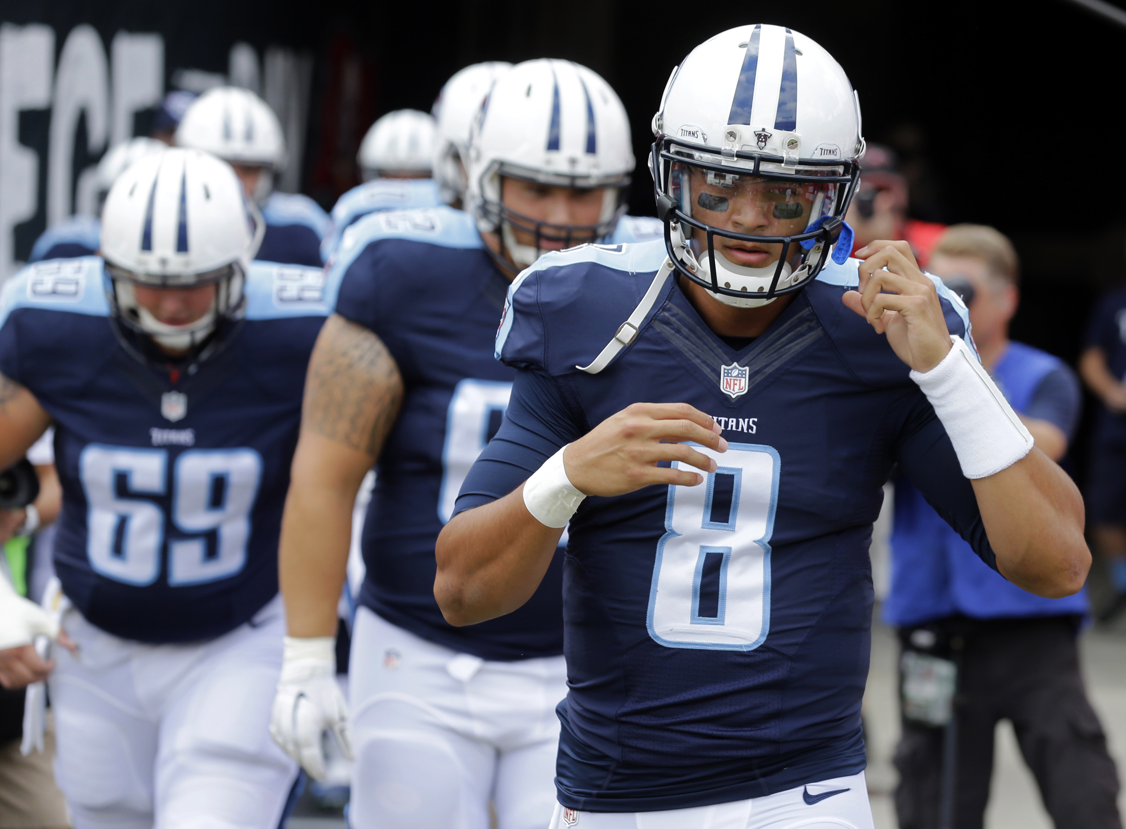 FILE - In this Sept. 13, 2015, file photo, Tennessee Titans quarterback Marcus Mariota (8) leads his teammates on to the field before an NFL football game against the Tampa Bay Buccaneers in Tampa, Fla. Mariota turned in a perfect passer rating in his NFL