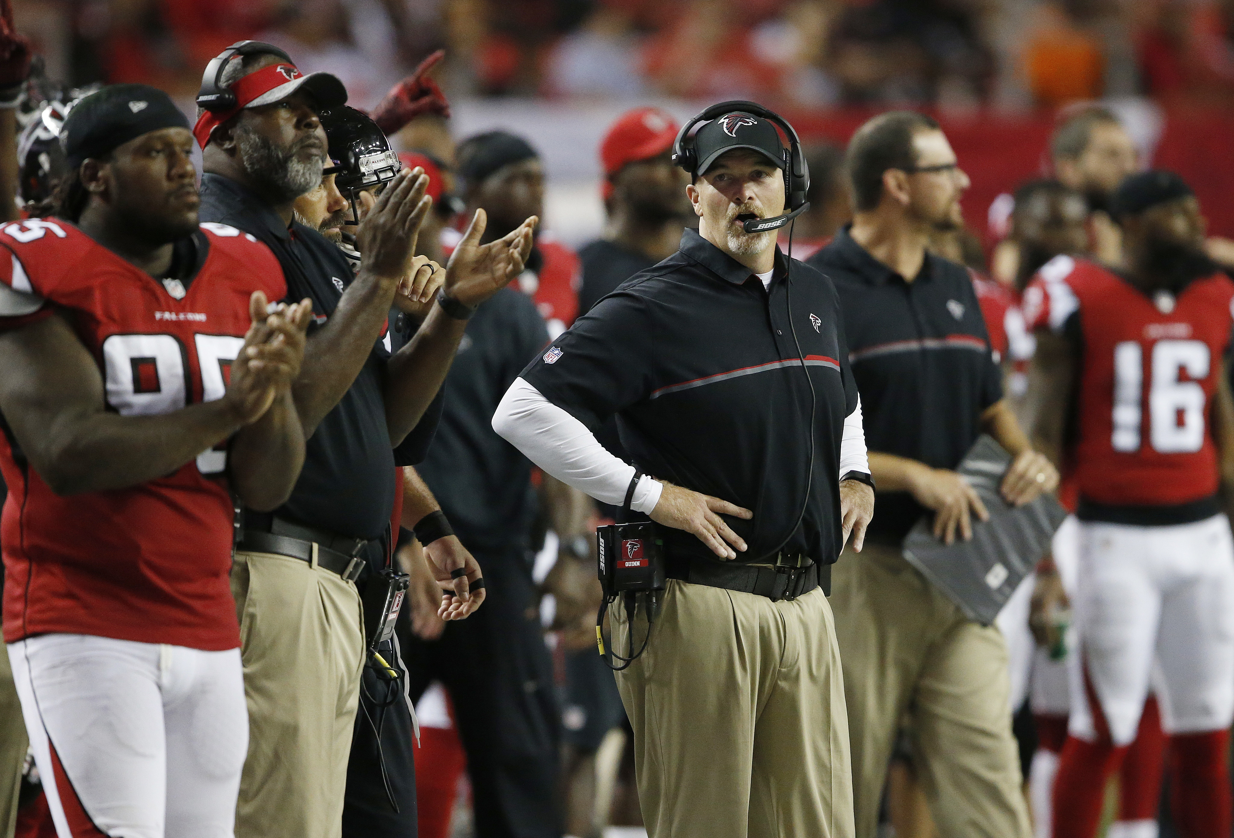 FILE - In this Sept. 1, 2016, file photo, Atlanta Falcons head coach Dan Quinn watches play against the Jacksonville Jaguars during the first half of a preseason NFL football game in Atlanta. Quinn says his team has grown closer since the front office red