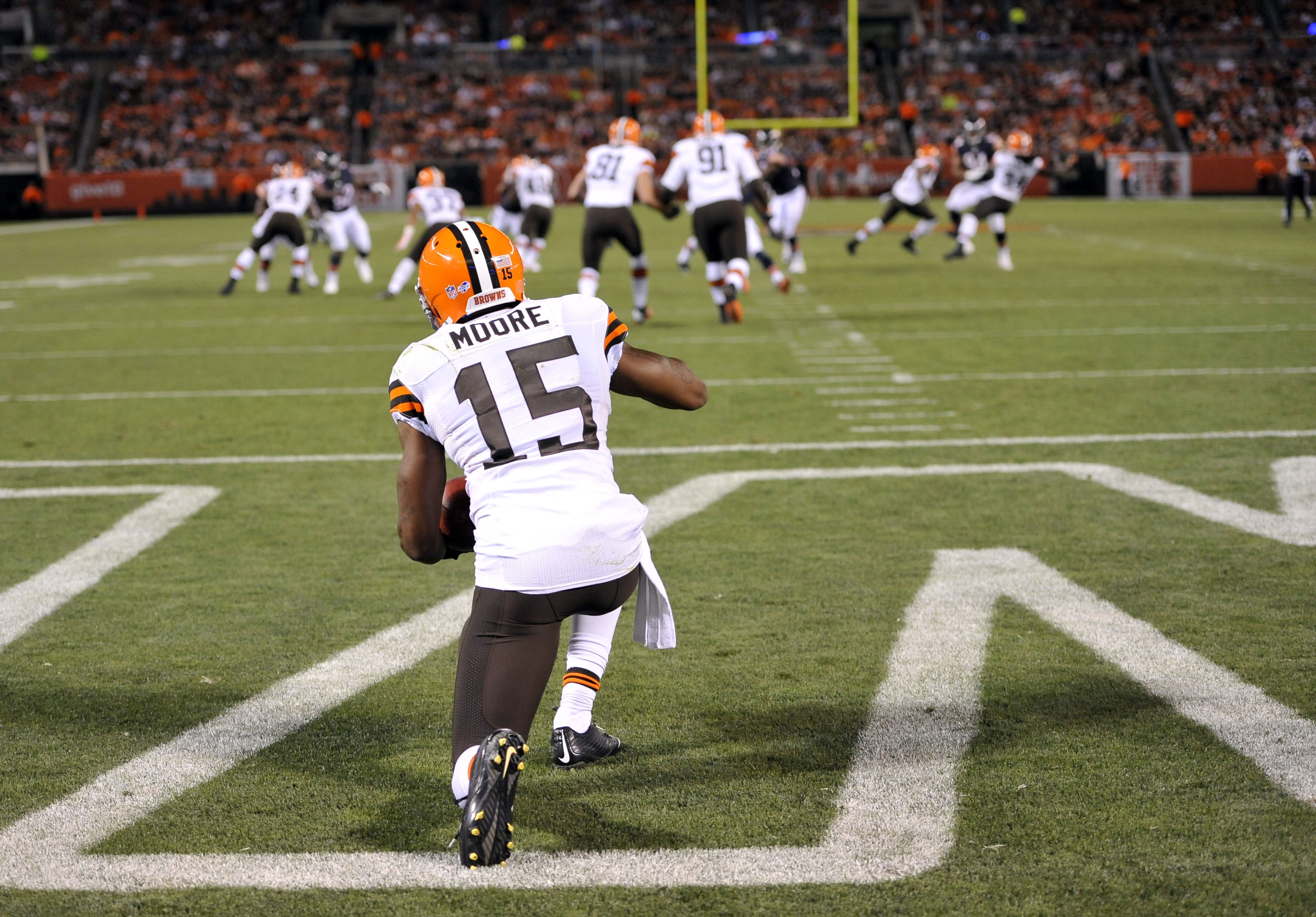 FILE - In this Aug. 28, 2014, file photo, Cleveland Browns' Marlon Moore (15) takes a knee for a touchback in the second quarter of a preseason NFL football game against the Chicago Bears in Cleveland. Exhibition games serve a purpose for people such as o